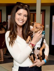 Katherine Schwarzenegger with Tuna the dog at opening of The Wallis Annenberg PetSpace on June 24, 2017 in Playa Vista, Calif.