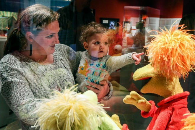 Madi Adkins and her son Neely look at the Fraggle Rock characters displayed at the Jim Henson Exhibition: Imagination Unlimited Saturday, Jan. 12, 2019, at the Mississippi Arts + Entertainment Experience in Meridian, Miss. (Paula Merritt/The Meridian Star via AP)