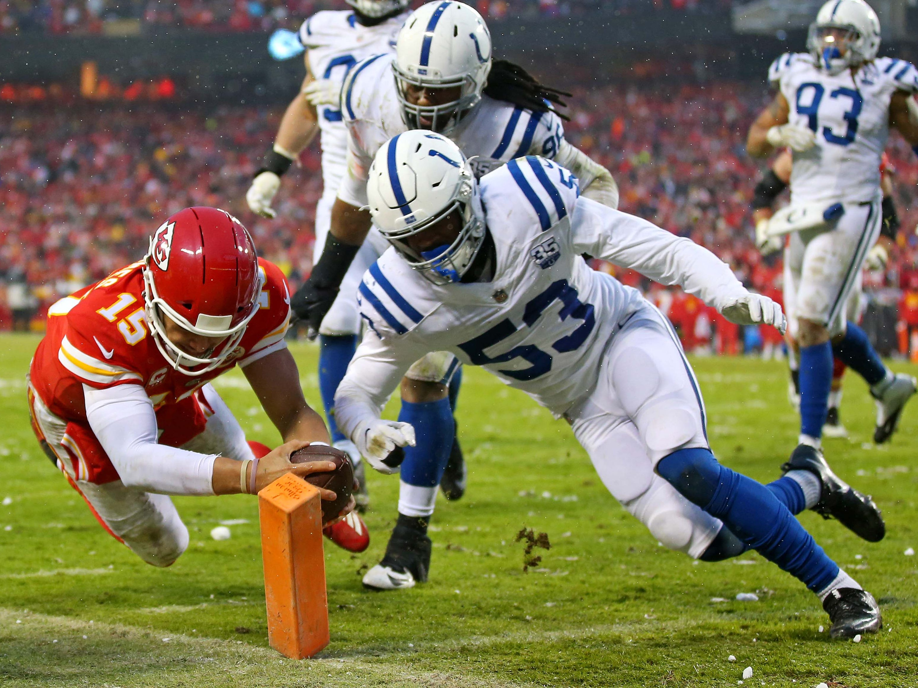 Divisional playoffs: Kansas City Chiefs quarterback Patrick Mahomes scores a touchdown against the Indianapolis Colts during the second quarter in the AFC divisional playoffs at Arrowhead Stadium. The Chiefs won the game, 31-13.