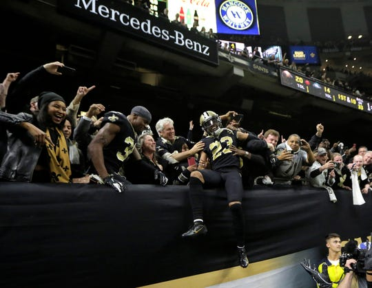 New Orleans Saints cornerback Marshon Lattimore (23) celebrates with fans after intercepting a circulation against the Philadelphia Eagles all around the fourth quarter of a NFC Divisional playoff soccer game at Mercedes-Benz Superdome.