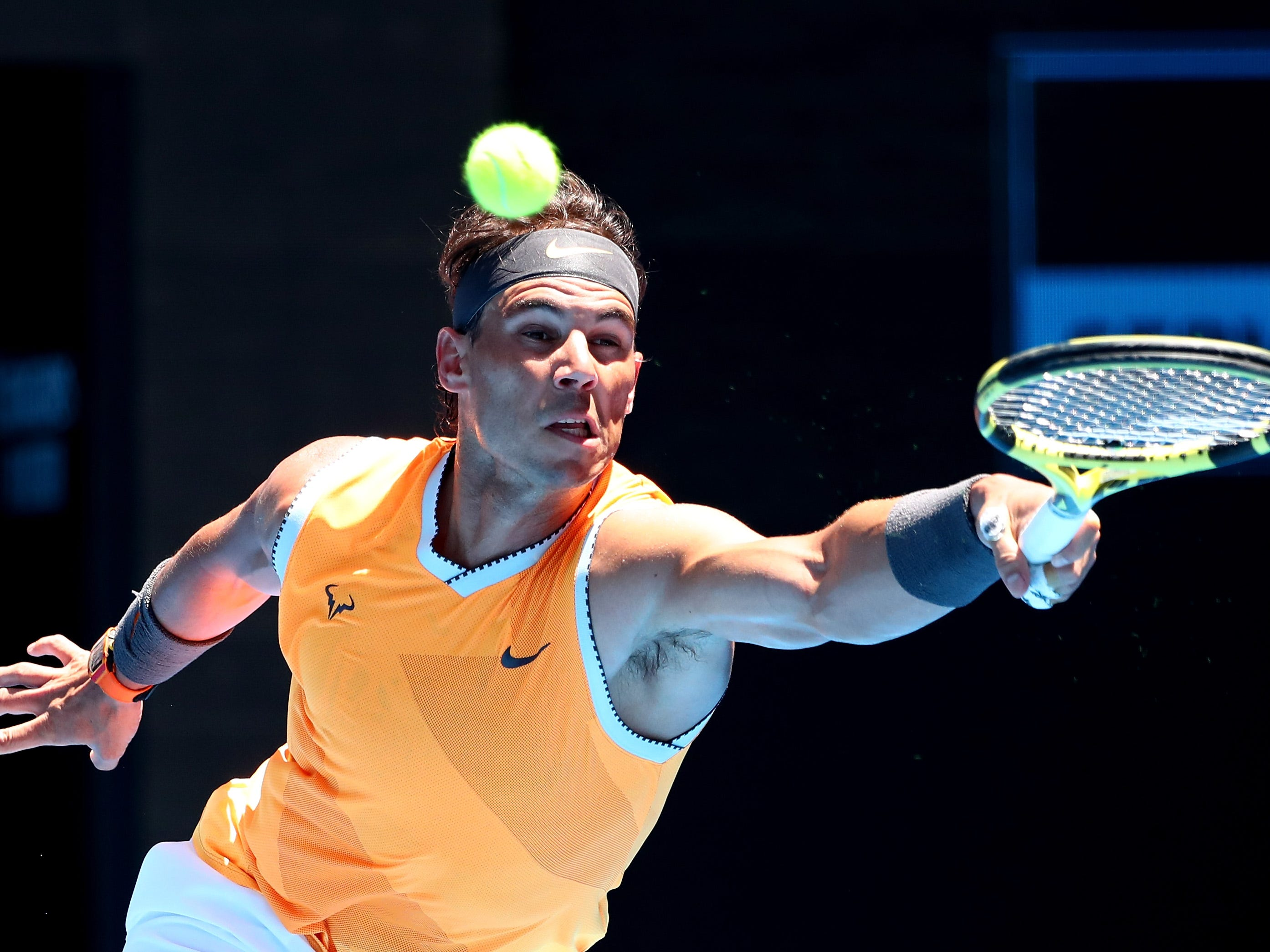 No. 2 seed Rafael Nadal, stretching to play a forehand, earned a comfortable 6-4, 6-3, 7-5 first-round win over Australian James Duckworth.