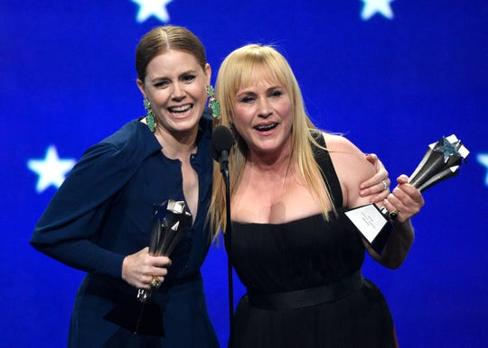 Amy Adams, left, and Patricia Arquette accept the award, a tie, for best actress in a limited series or movie made for television at the 24th annual Critics' Choice Awards.