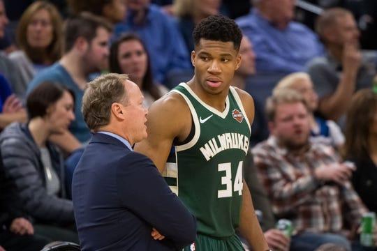 Milwaukee Bucks head coach Mike Budenholzer talks to forward Giannis Antetokounmpo.