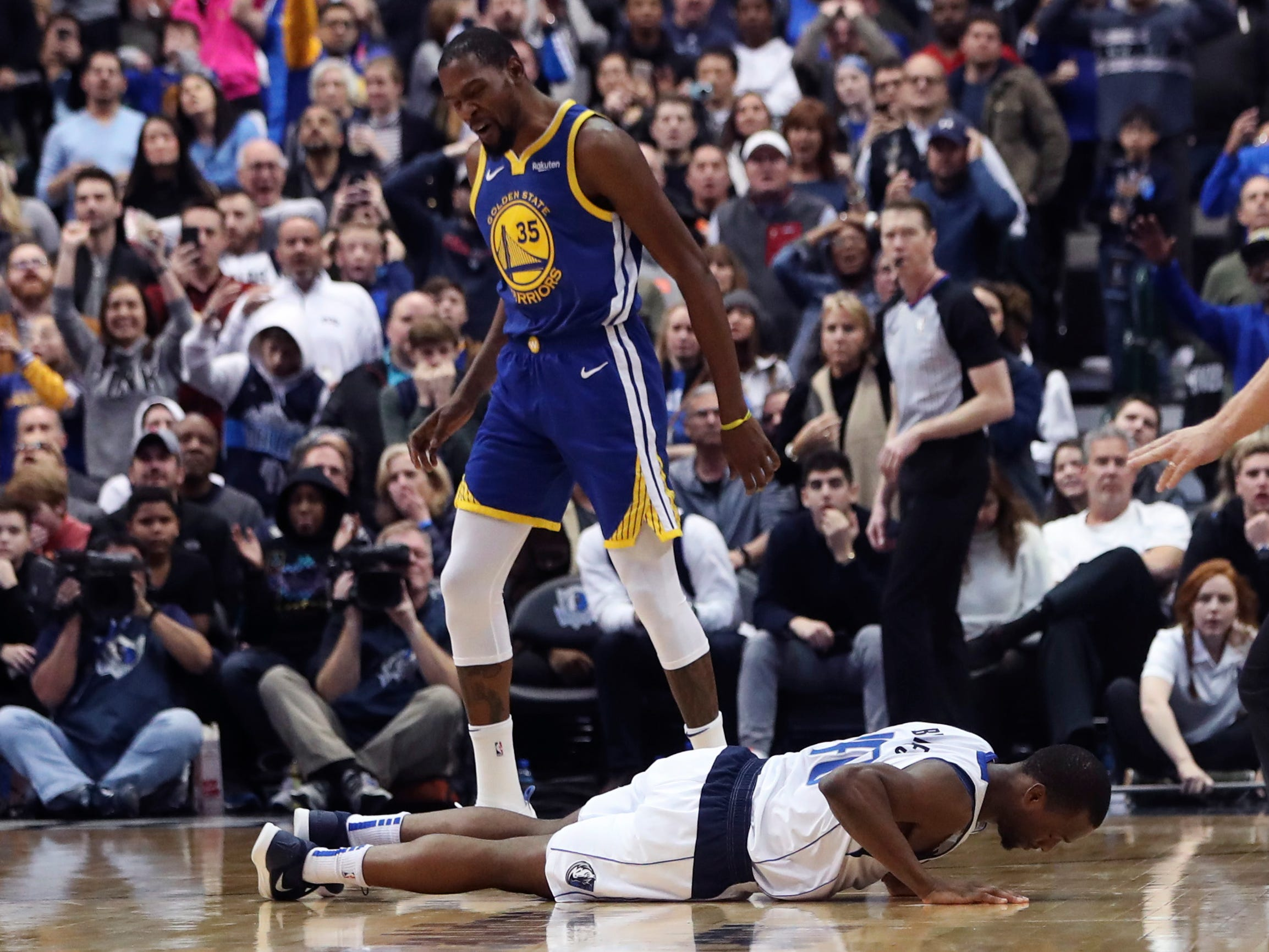 Jan. 13: Mavericks forward Harrison Barnes (40) laments his costly turnover in the closing seconds that allowed Kevin Durant (35) and the Warriors to escape Dallas with a win.