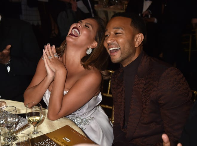 Chrissy Teigen and John Legend were having an all-star time at Sunday's awards show.