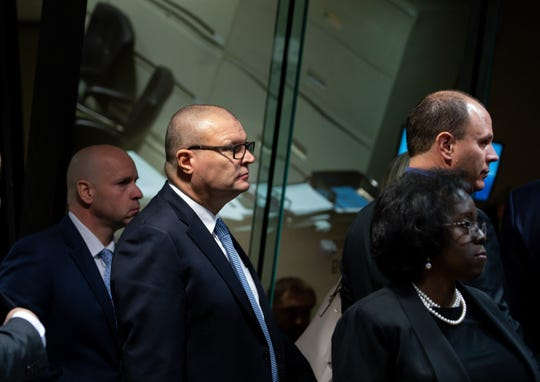 Ex-Officer Joseph Walsh, from second left, back, former Detective David March and Chicago Police Officer Thomas Gaffney arrive in court on the first day of the trial with Judge Domenica Stephenson at Leighton Criminal Court Building in Chicago on Nov. 27, 2018.