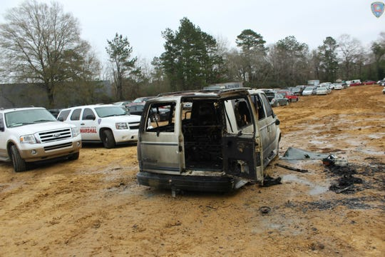 An employee of a Pineville auto shop was burned Tuesday morning after a mishap as he was working on the gas tank of this GMC van.