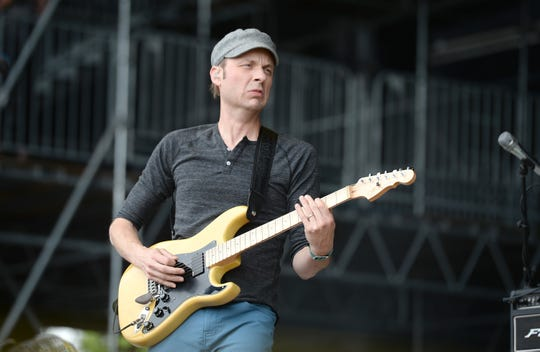 Jake Cinninger plays with his band Umphrey's McGee at the Bonnaroo Music & Arts Festival in 2014.