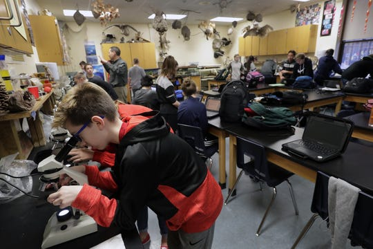 Riley Szymik uses a microscope while working on a lab project during his seventh-grade life science class at Shattuck Middle School in Neenah. The replacement of the school is the centerpiece of a $129.6 million referendum in April.