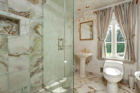 The master bath offers marble flooring and a spa-like tub.