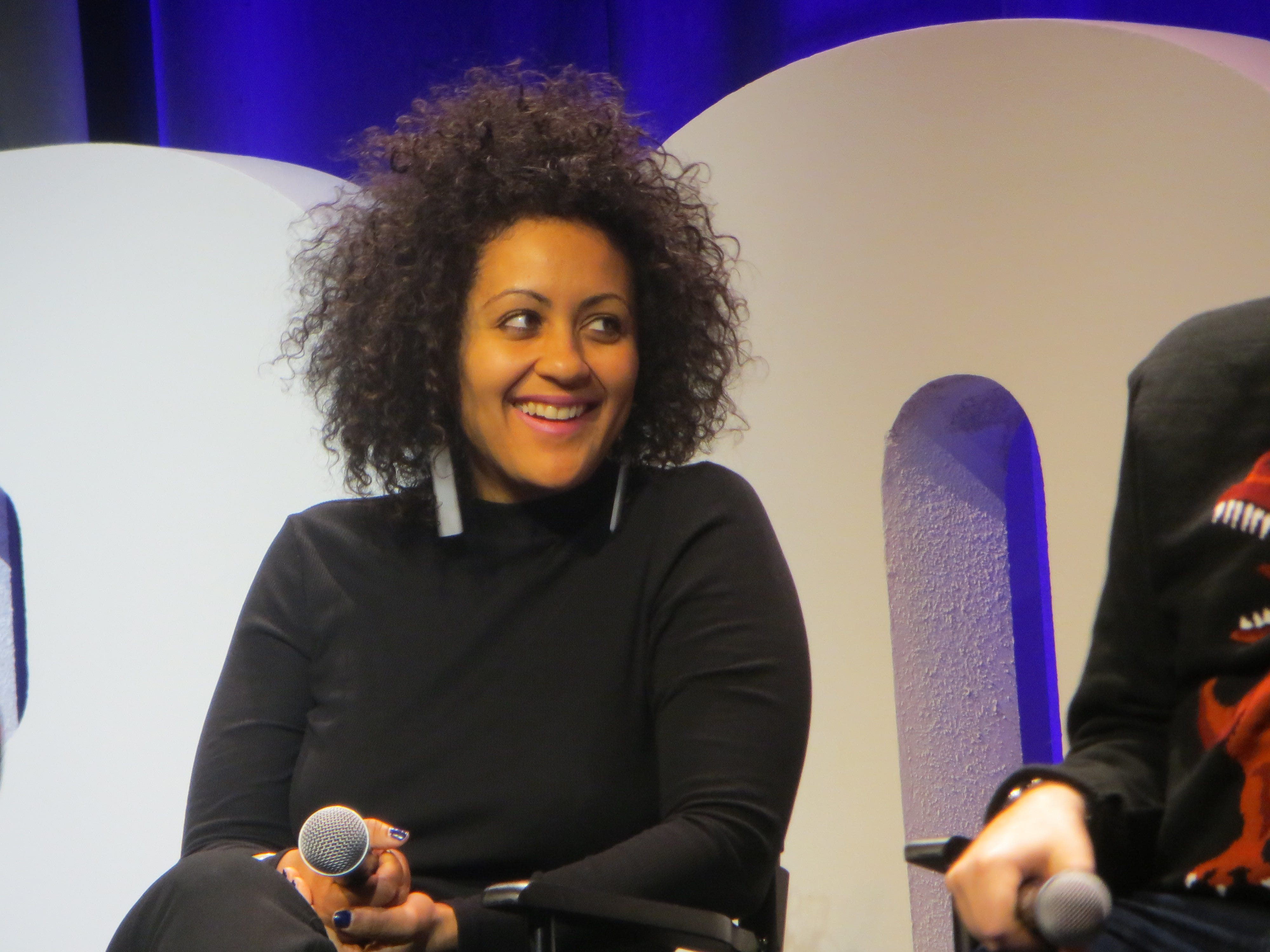 Lileana Blain-Cruz speaks during the New York Theatre Workshop at 40 panel at BroadwayCon 2019, held Jan. 11 to 13, 2019, at the New York Hilton Midtown in Manhattan.