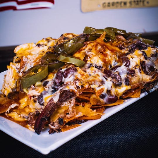 The nachos at Jersey Shore BBQ in Belmar are topped with cheese, beans, jalapenos and meats: pulled pork, brisket burnt ends, pulled chicken.