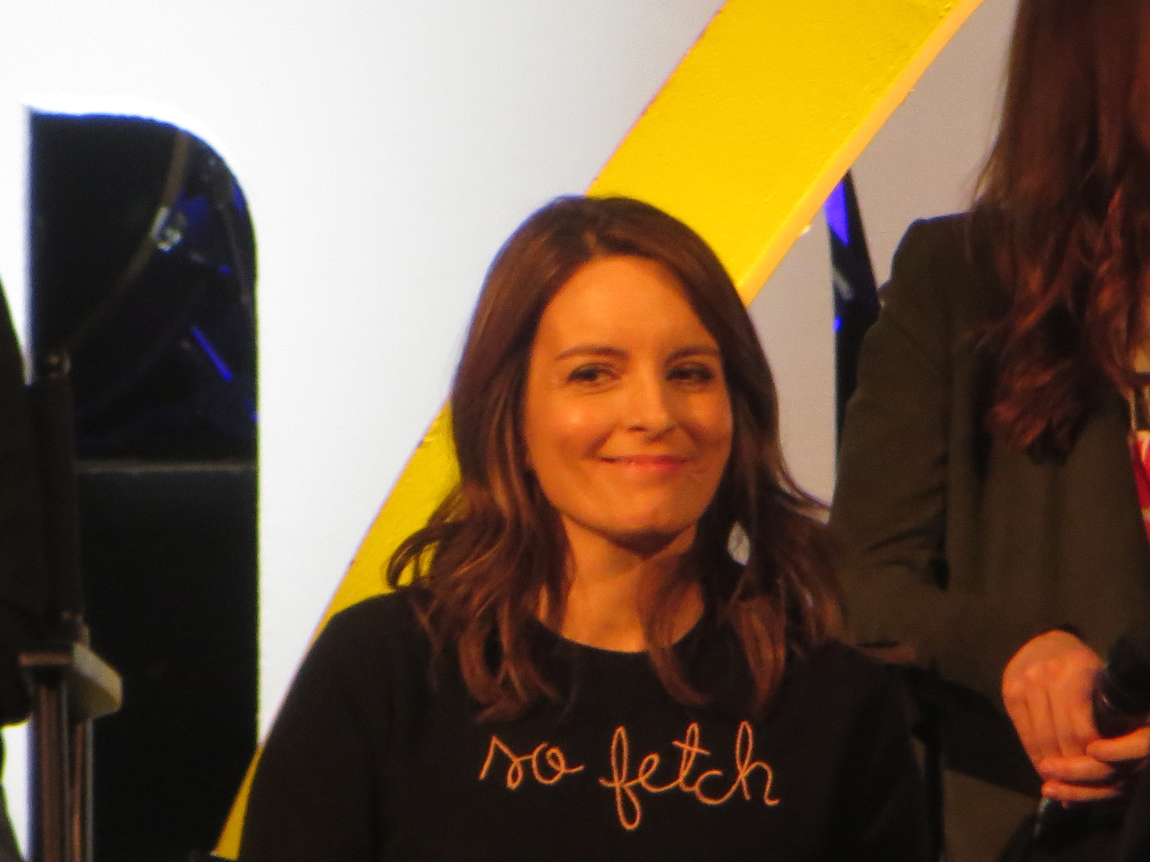 "Tina Fey smiles during a spotlight on ""Mean Girls"" at BroadwayCon 2019, held Jan. 11 to 13, 2019, at the New York Hilton Midtown in Manhattan."