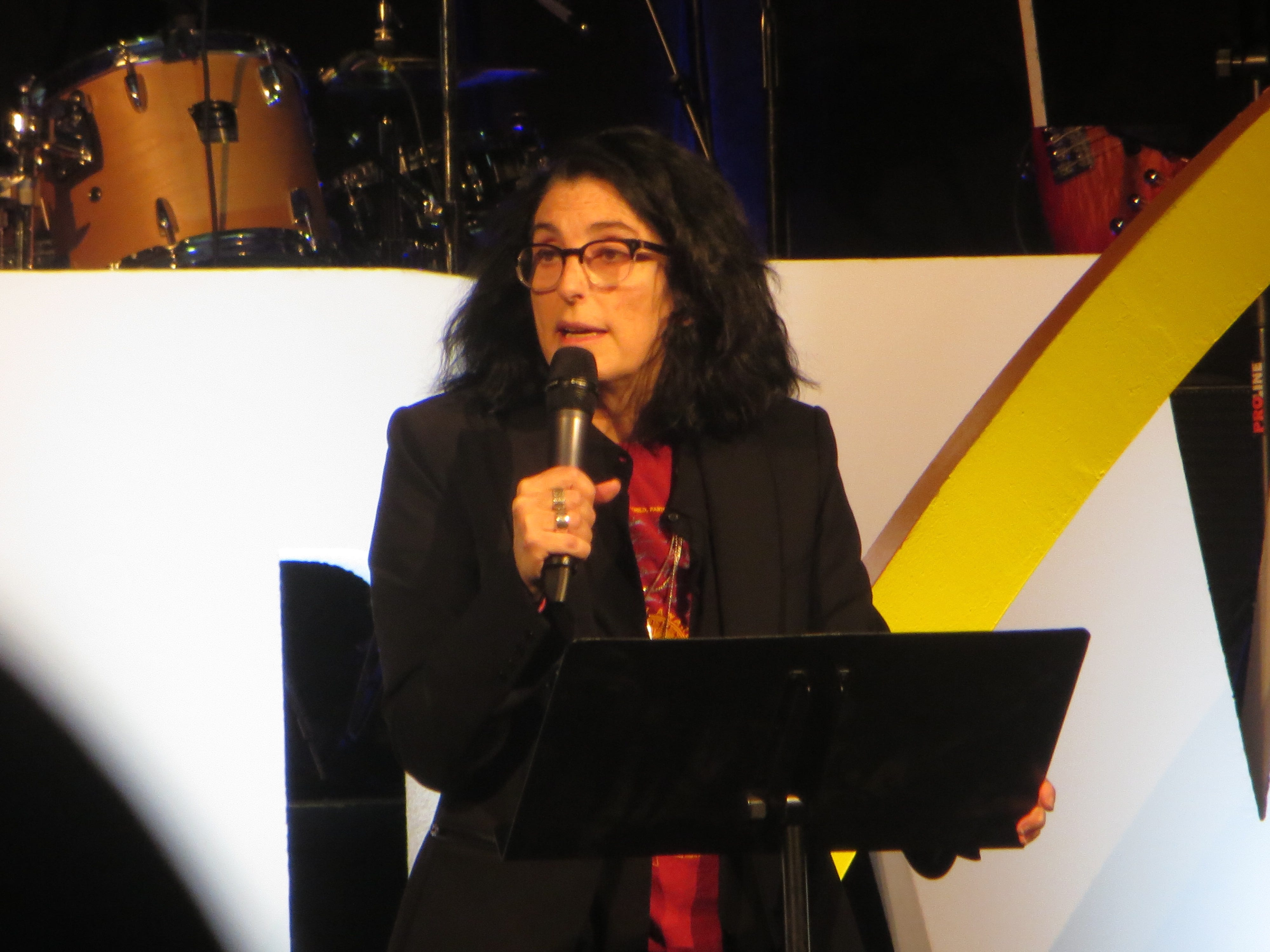 Tina Landau speaks during the opening ceremony at BroadwayCon 2019, held Jan. 11 to 13, 2019, at the New York Hilton Midtown in Manhattan.
