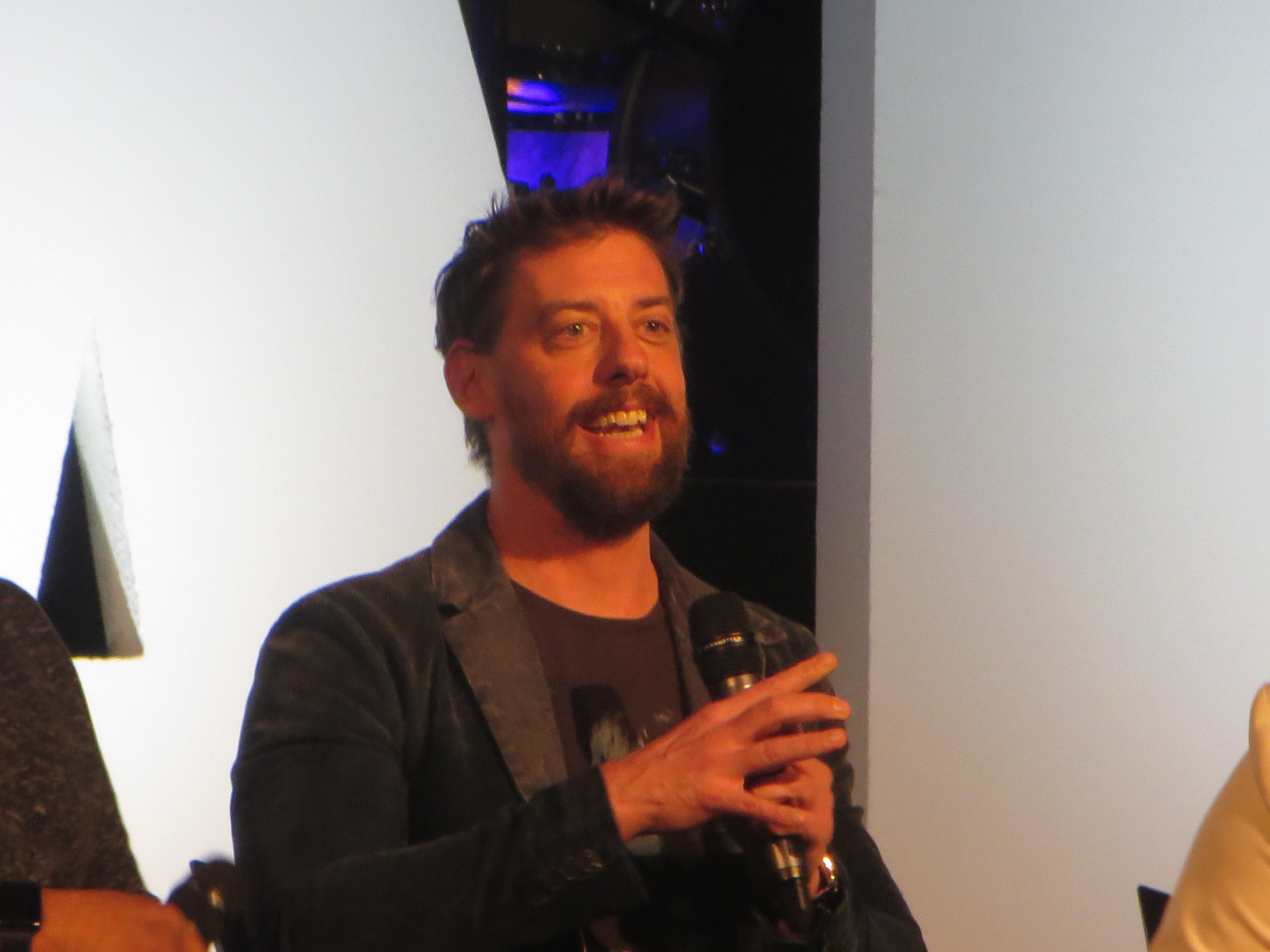Christian Borle speaks during a Disney on Broadway at 25 panel at BroadwayCon 2019, held Jan. 11 to 13, 2019, at the New York Hilton Midtown in Manhattan.