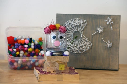 Lauren Stout. owner of Creativity Lab, a business that offers classes, workshops and parties for kids with fun activities like building robots, crafting and woodworking, displays a candy dispenser and string art created at a craft/woodcraft birthday party at Creativity Lab in Belmar, NJ Tuesday January 15, 2019.