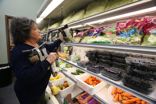 Patricia Donaghue, executive director and CEO of Peoples Pantry, stocks produce as she talks about donations and how the pantry is waving eligibility requirements for furloughed federal workers at Peoples Pantry in Toms River, NJ Tuesday January 15, 2019.