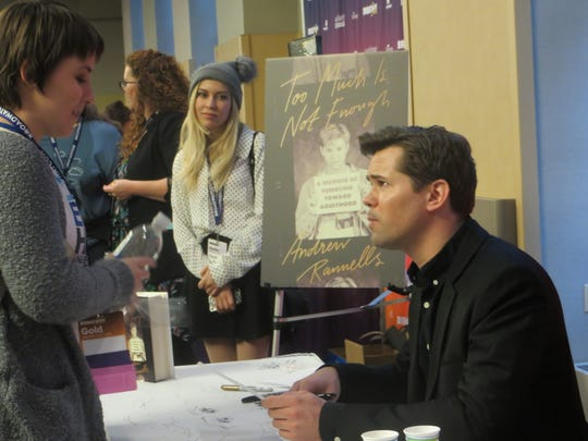 Andrew Rannells signs an autograph for a fan at BroadwayCon 2019, held Jan. 11 to 13, 2019, at the New York Hilton Midtown in Manhattan.