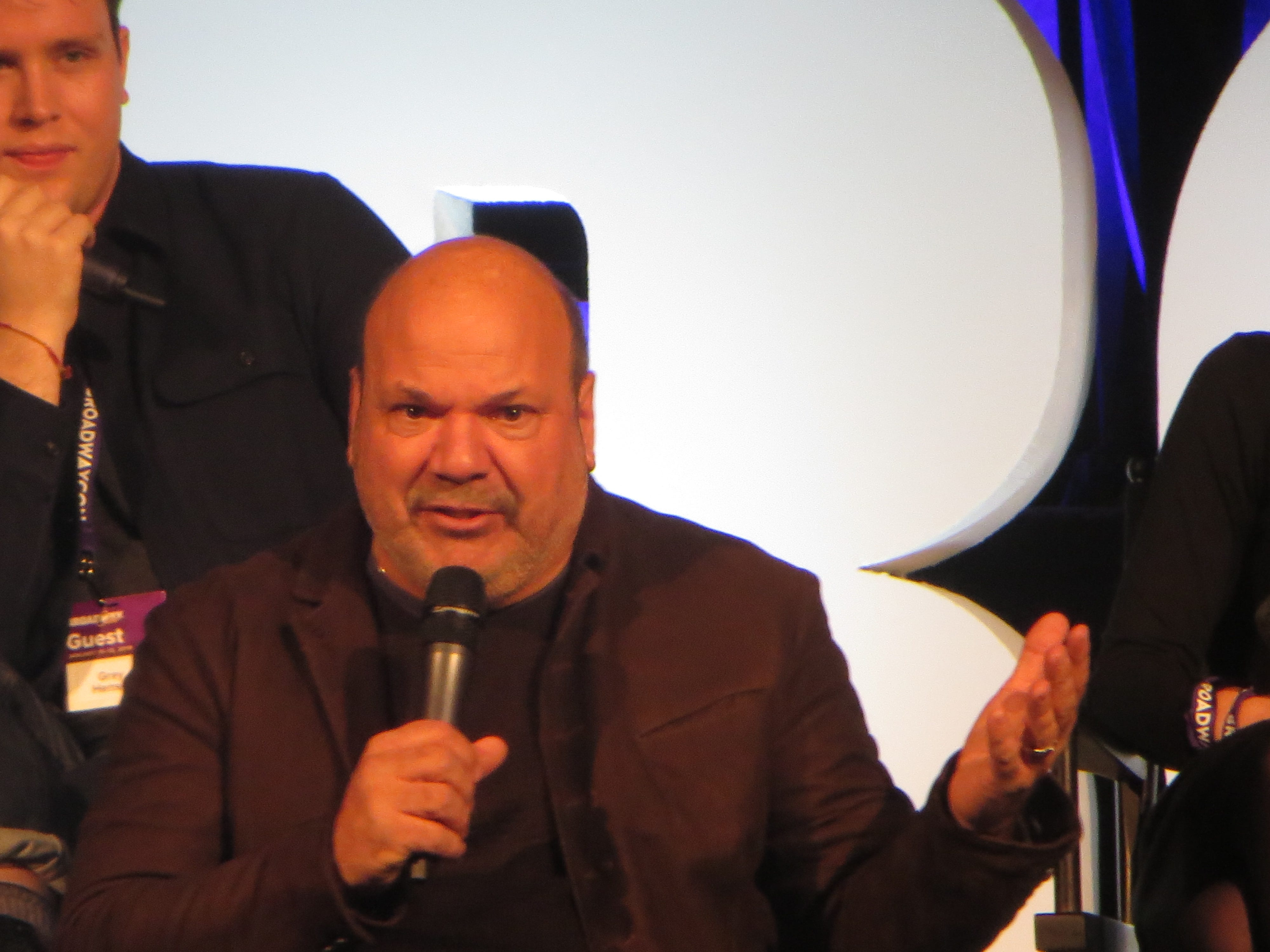 "Casey Nicholaw speaks during a ""Mean Girls"" spotlight at BroadwayCon 2019, held Jan. 11 to 13, 2019, at the New York Hilton Midtown in Manhattan."