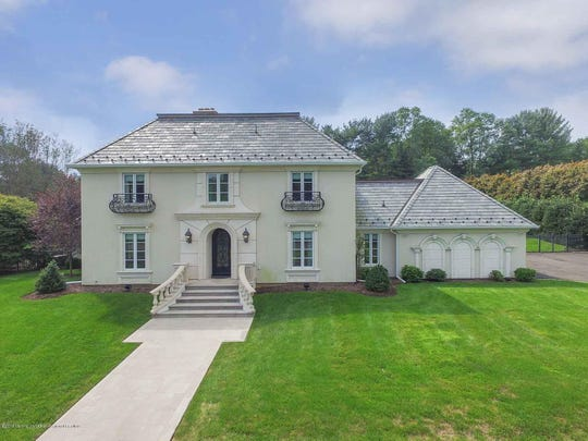 Rumson home at 6 Woods End Road beams with exquisite chateau style.
