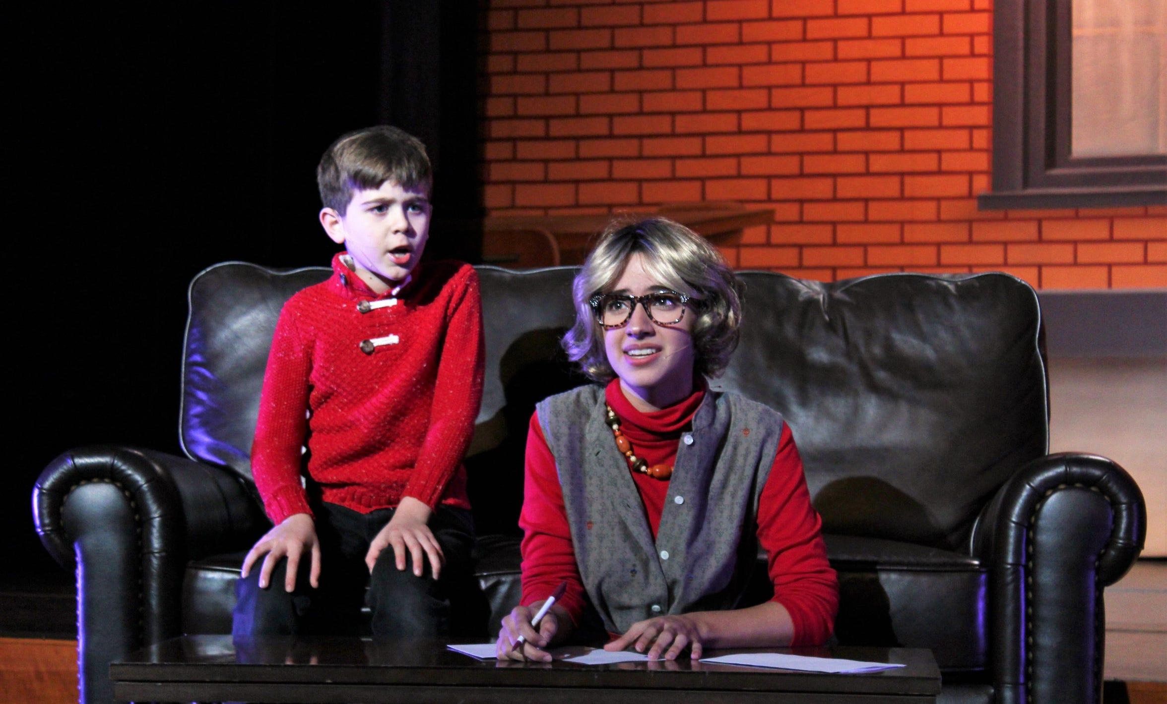 "Buddy promises Michael Hobbs (Phoenix Lowe) he'll fix his fan is Michael writes a letter to Santa Claus. Michael and his mom, Emily (Mary Moore), give that a go in this rehearsal scene from ""Elf, the Musical, Jr."" at the Paramount Theatre."