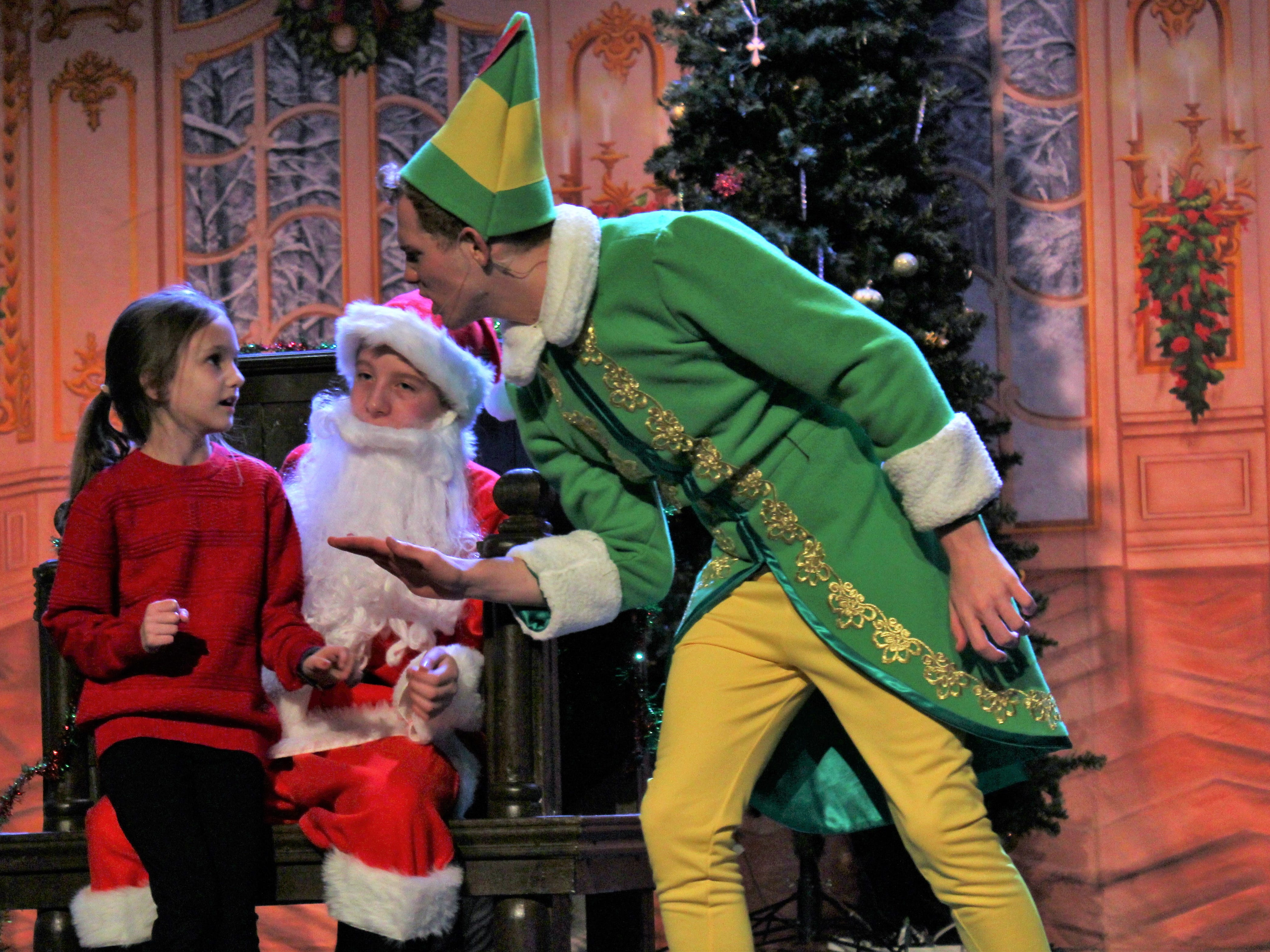 "Buddy (Brent Bardin) warns a girl on Santa's knee that he's not real and not to tell him anything in this rehearsal scene from ""Elf, the Musical, Jr."" at the Paramount Theatre."