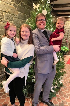 David Romanik will become rector of Episcopal Church of the Heavenly Rest in May. He formerly served the church as curate and associate rector. He is shown with his wife, Sarah Beth, and daughters Cecilia, 4, and Elizabeth, 18 months.