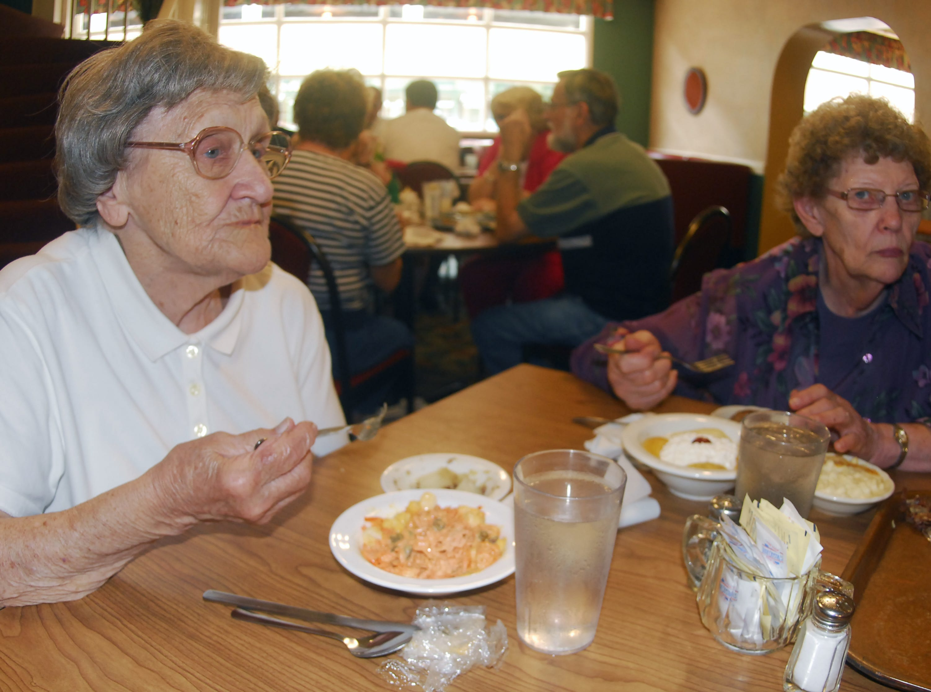 Lucille Pamelee (L) and Grace Donley talk about enjoying the food and service for years as they eat lunch at Shrank's Cafeteria which is closing for the summer with plans to reopen in fall 2010.