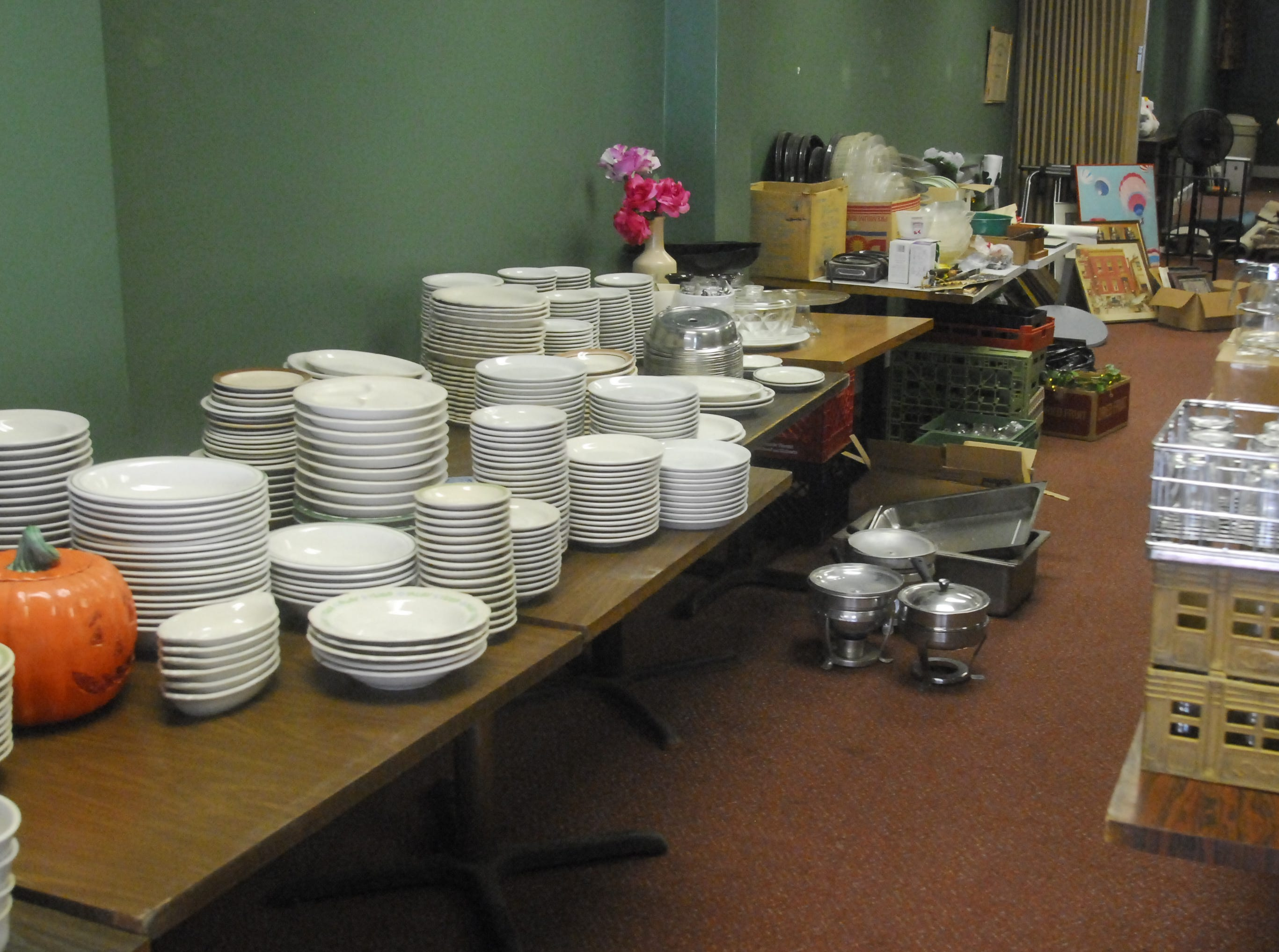 The garage sale at Shrank's Cafeteria features items i.e. plates, glassware, cookbooks and  artwork in 2010.
