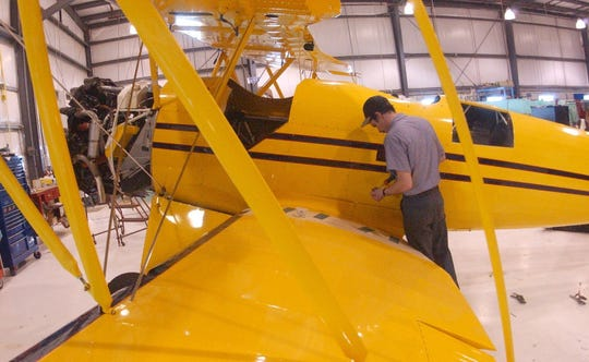Russ McCarn building a 1930 vintage style biplane at Waco Classic Aircraft in 2003.