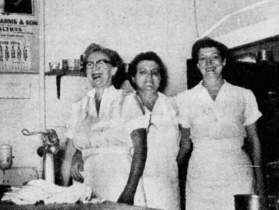 Shrank's Cafeteria employees Daisy, Clara and Flo, in the kitchen in 1954.
