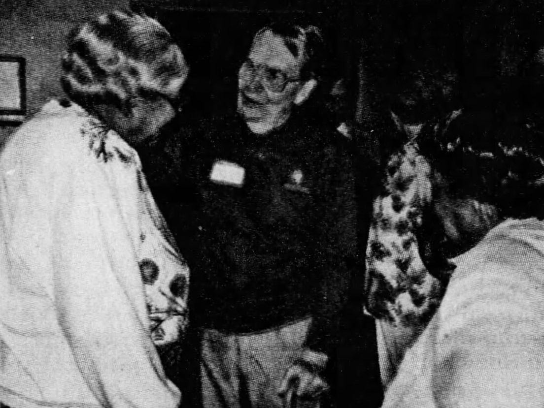 Roy Shrank greets friends and employees during a company Christmas party, circa 1990.