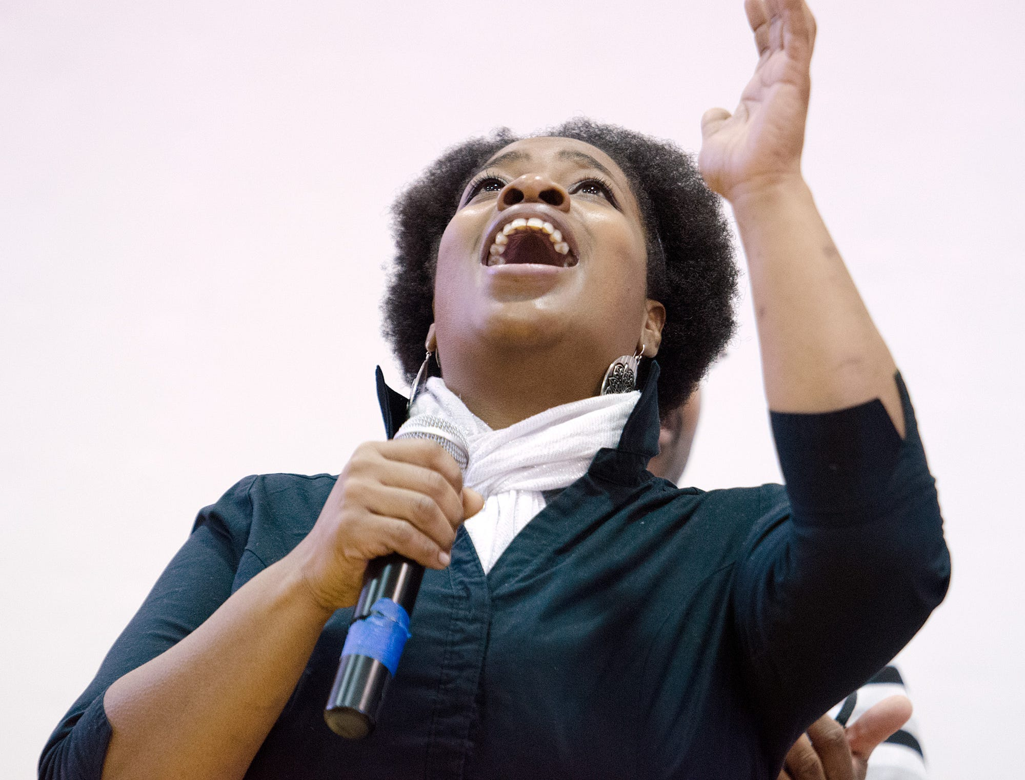 2014: A member of the Baptized Church of Jesus Christ choir sings a solo during the annual Martin Luther King Jr. Community Breakfast and Awards Ceremony in Ithaca.