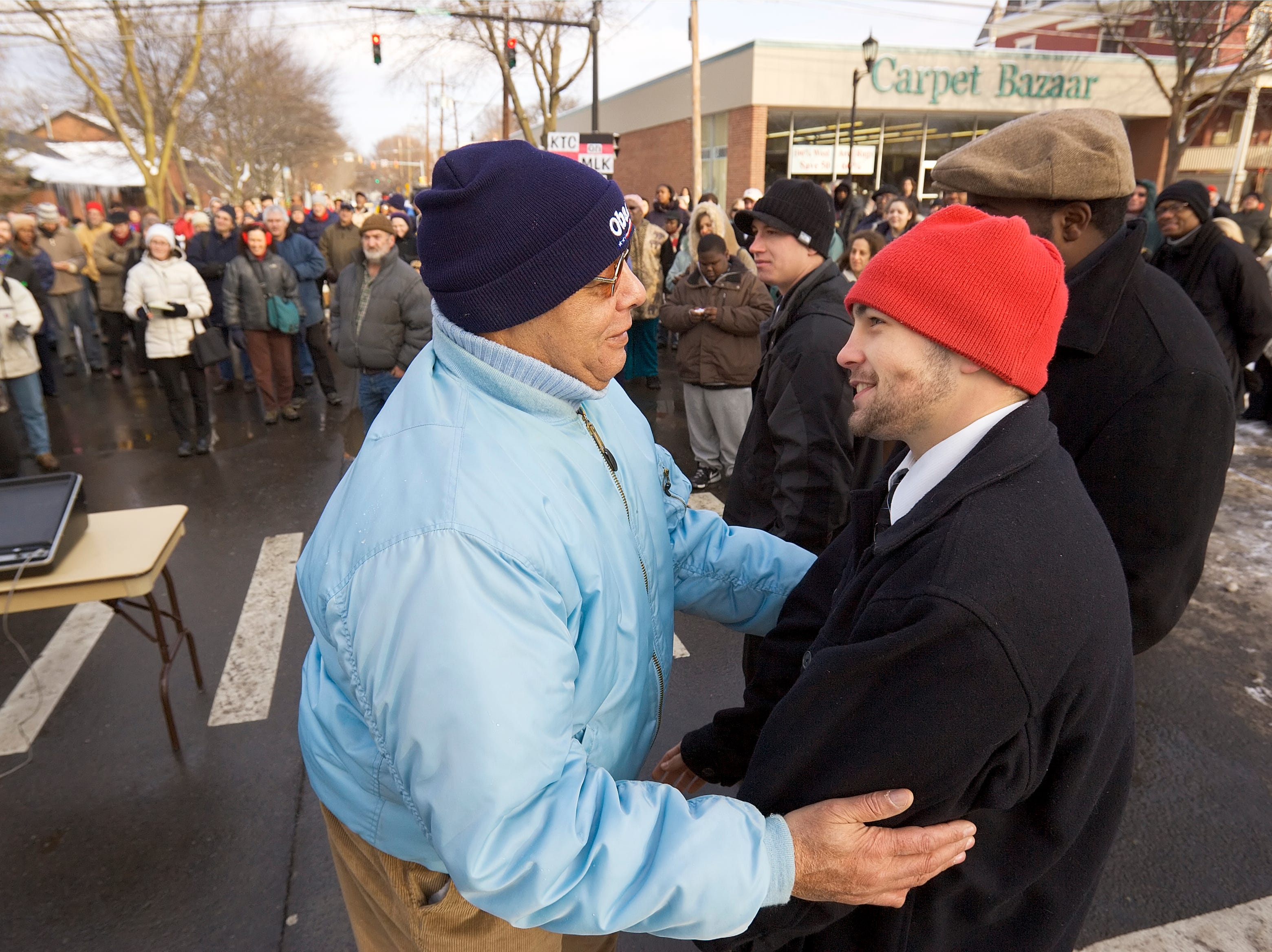 2009: Gino Bush, left and Dane Schreiner embrace after Schreiner, a former member of Gino Bush's Circle of Recovery group at Ithaca High School, spoke Monday morning at the formal unveiling ceremony for the dual naming of State Street in honor of Martin Luther King Jr.