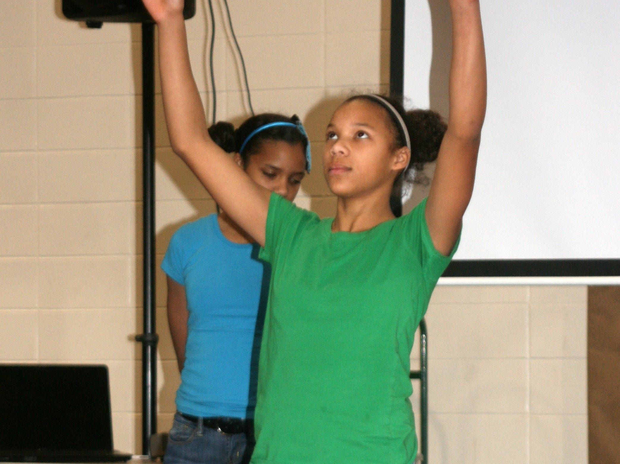 2012: Members of the Shazer family perform Monday afternoon during the 14th annual Together We Dine event held at the Ernie Davis Community Center in Elmira to honor Dr. Martin Luther King Jr.