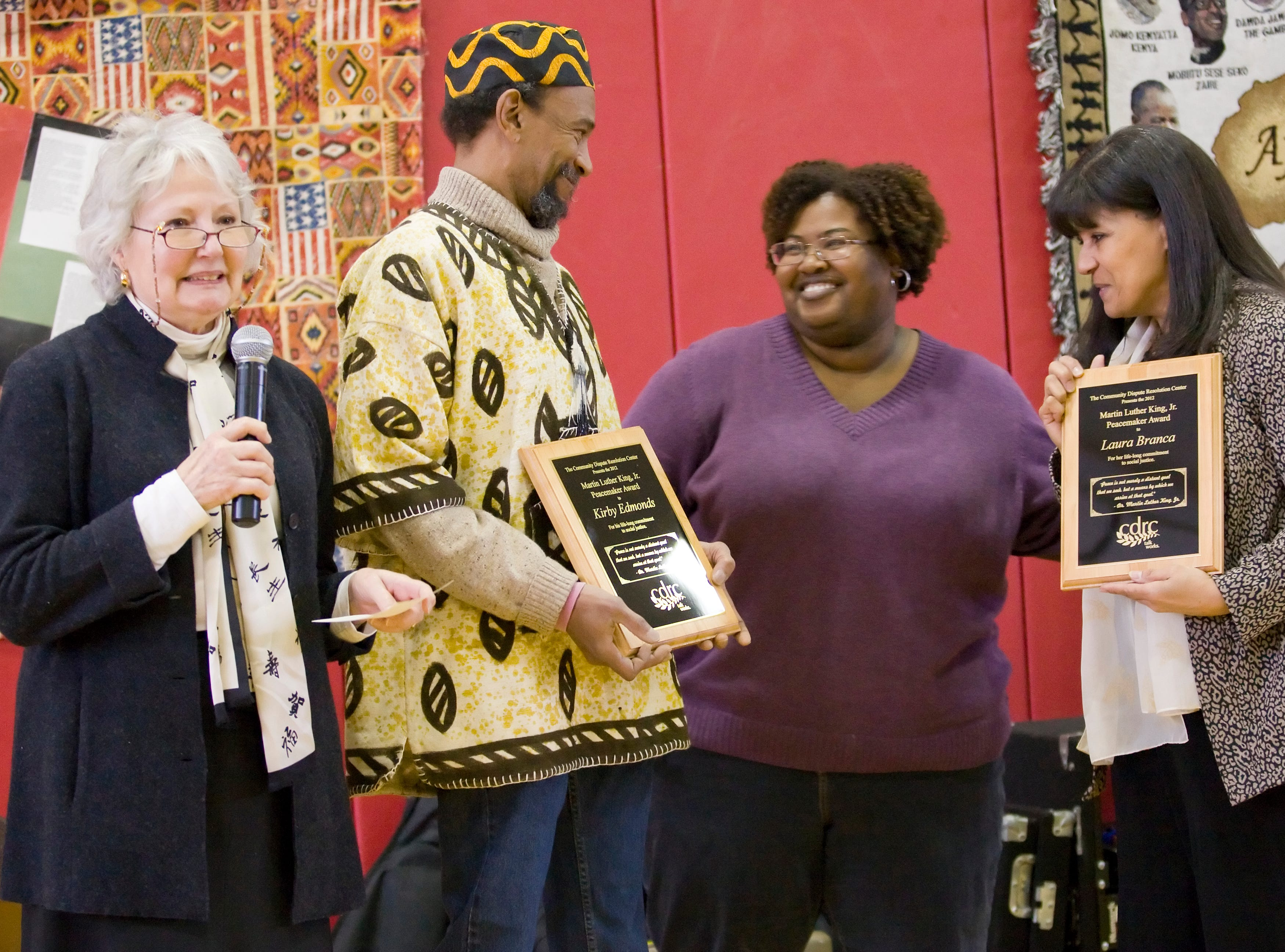 2012: Ann Martin, the President of the Community Dispute Resolution Center, left, announces as Ayana Richardson, the president of the Greater Ithaca Activities Center board, presents the CDRC Martin Luther King Peacemaker Award to Kirby Edmonds, and Laura Branca, right, Saturday morning at the annual GIAC Martin Luther King Breakfast.