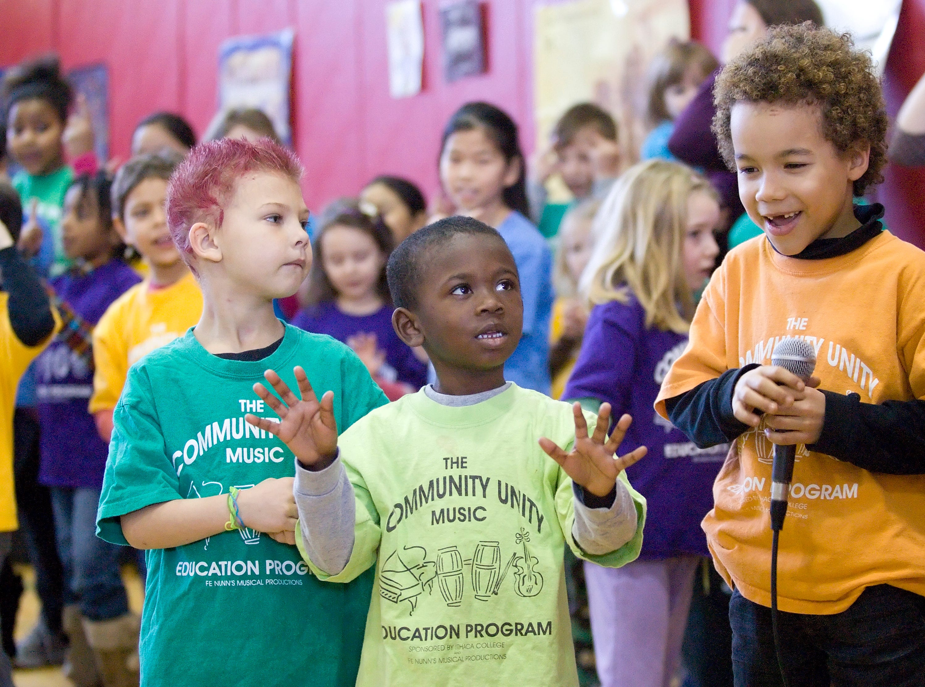 """2011: From left, Zabin Robinson and Jaden Mount, listen as Eamon Makepeace raps during the song """"Beautiful Colors"""" about the beauty of all types of skin color Monday afternoon at the Martin Luther King Jr. Day of Celebration organized by the Greater Ithaca Activities Center. More than 400 people attended the event in the Beverly J. Martin Elementary School in Ithaca."""