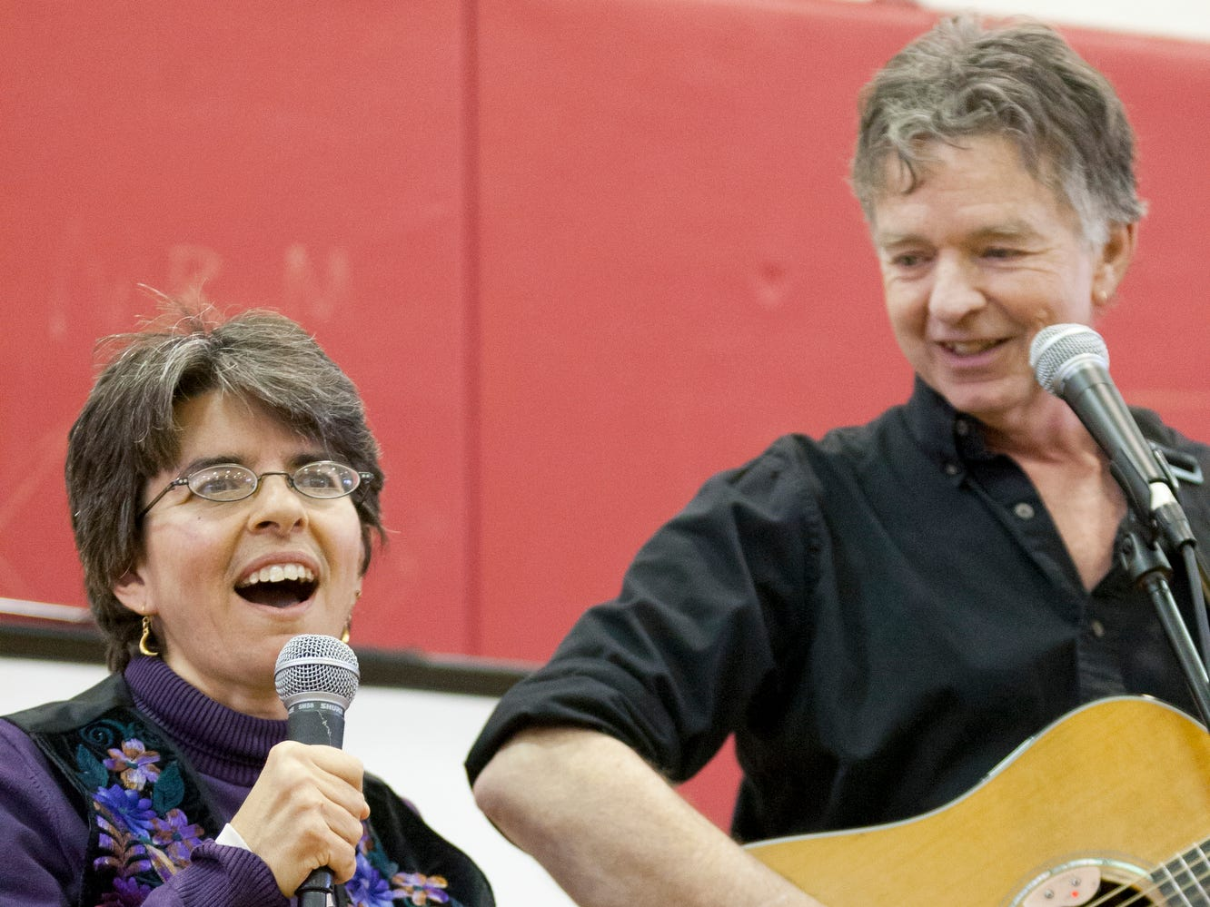 2014: Juliette Ramierz Corazon sings with John Simon Monday afternoon at the Martin Luther King Jr. luncheon held in the Beverly J. Martin School gym.