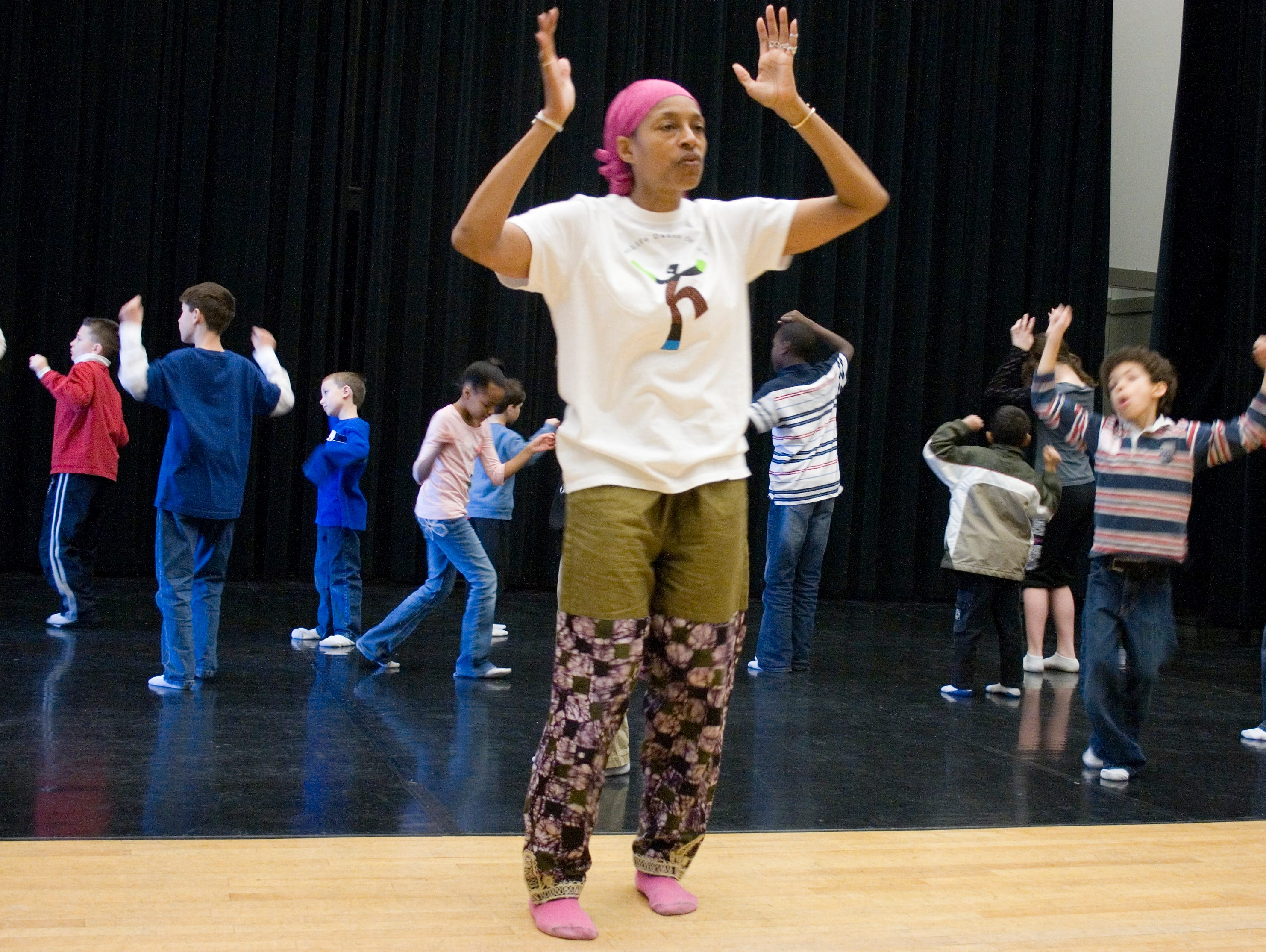 2008: Frances Hare, a teaching artist from Young Artists of Rochester, teaches children African dance moves Monday morning during Making Real the Dream at 171 Cedar Arts Center in Corning.