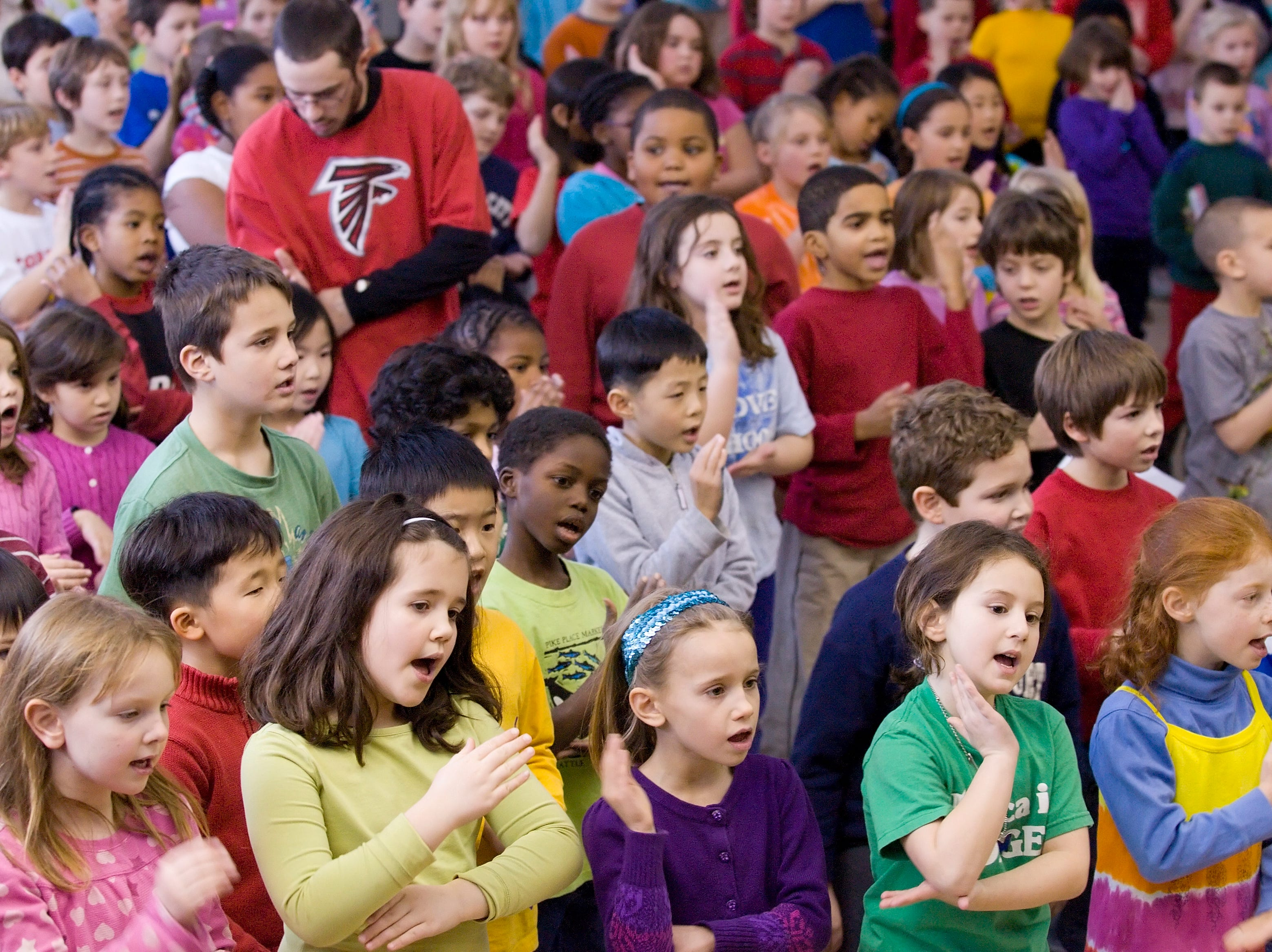 """2011: The students of Cayuga Heights Elementary School close their School Martin Luther King Jr. assembly Friday afternoon by signing """"We Shall Overcome"""" while following along in sign language."""