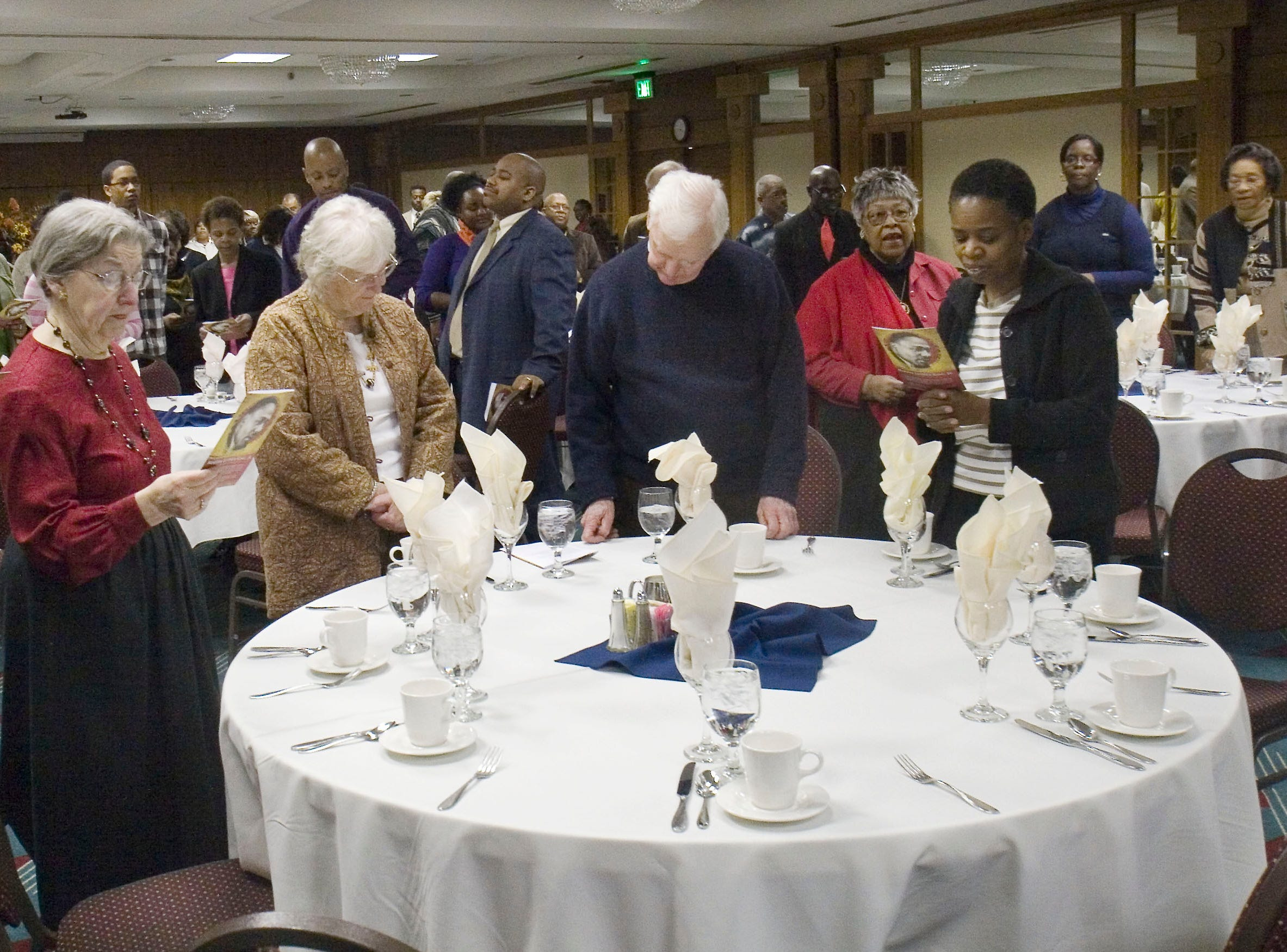 """2010: Martin Luther King Jr. breakfast participants join in the singing of  """"Lift Every Voice and Sing""""  before breakfast is served at Radisson Hotel in Corning Saturday. morning."""