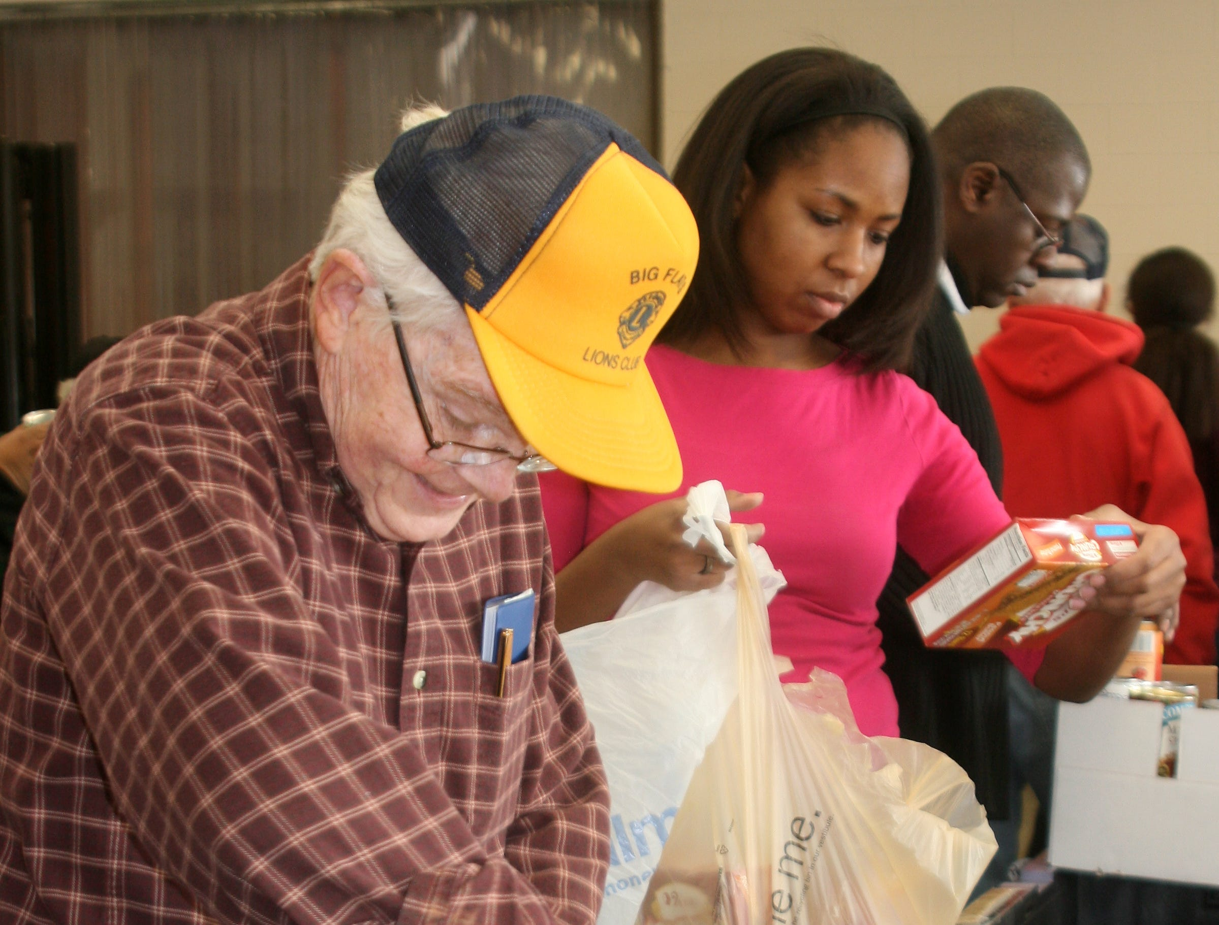 2012: Bill Powell, foreground, of Catlin, sorts canned goods Monday morning at Food Bank of the Southern Tier, 388 Upper Oakwood Ave., Elmira, during the agency's National Day of Service to honor Dr. Martin Luther King Jr.