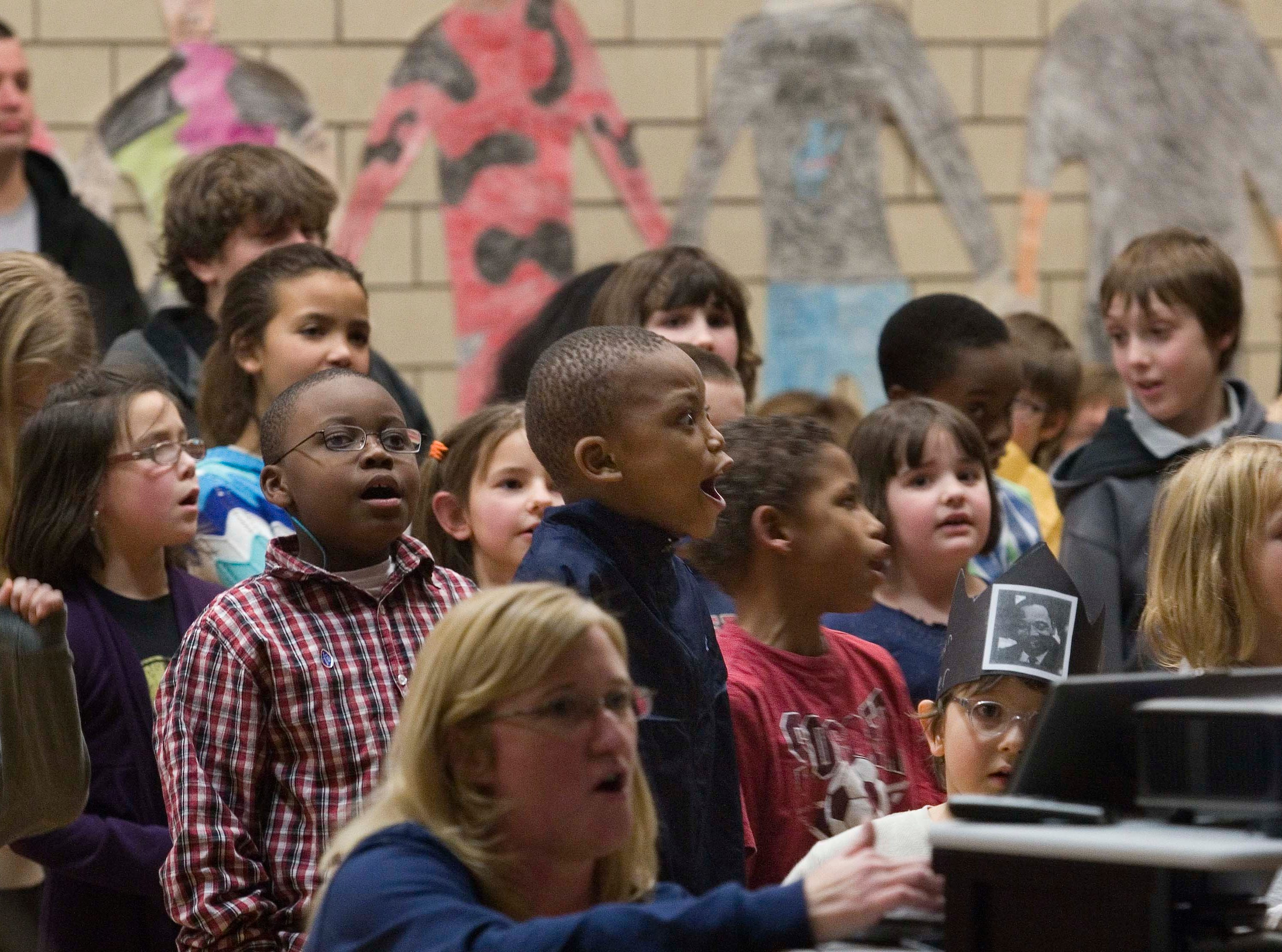 2010: Fassett Elementary School students  sing 'Everybody Ought to Know' as they honor the memory of Martin Luther King Jr. Friday afternoon.