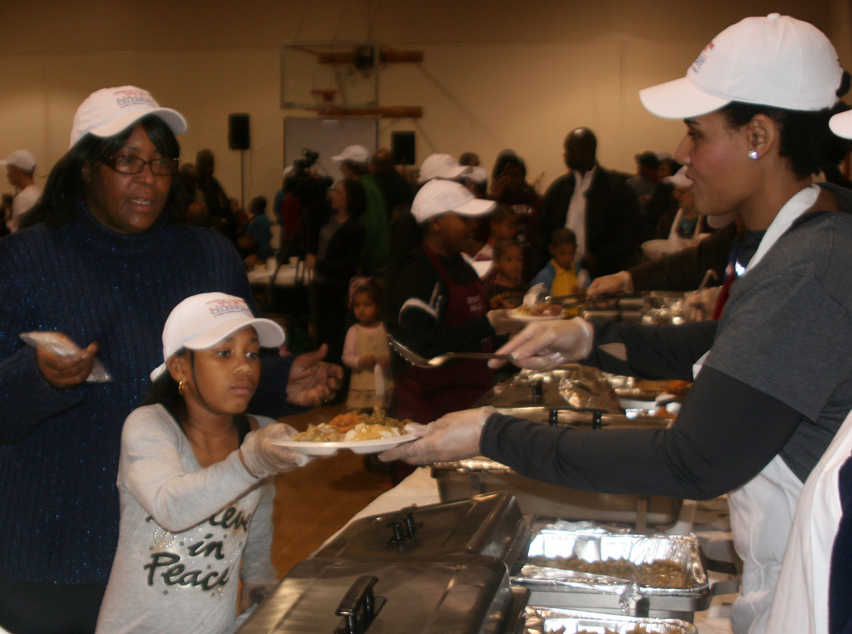 2012: Dinner is served Monday afternoon during the 14th annual Together We Dine event held Monday at the Ernie Davis Community Center in Elmira to celebrate the observance of Dr. Martin Luther King Jr. Day.