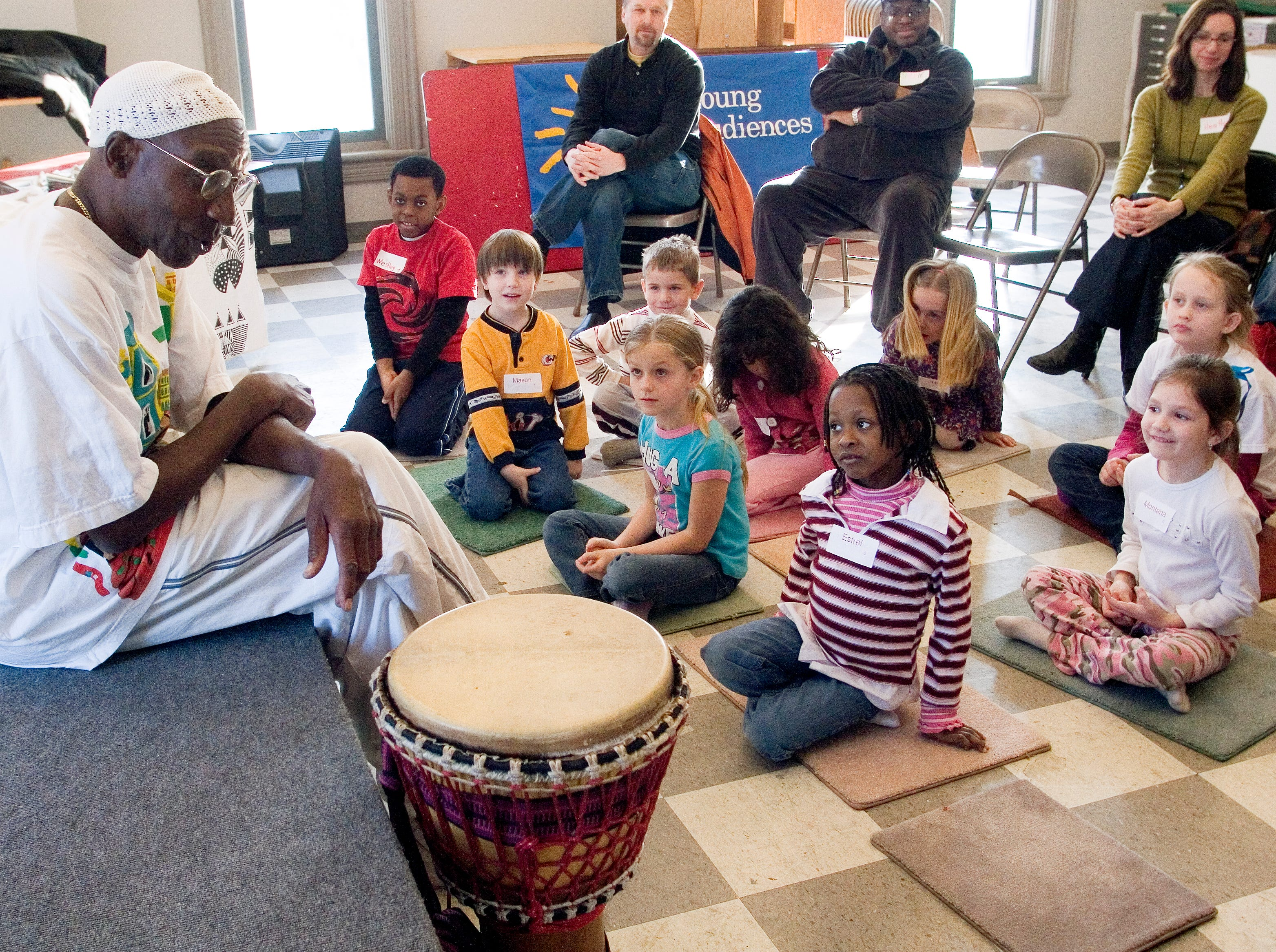 2009: Clyde Morgan, associated professor of dance at SUNY Brockport, introduces children to musical instruments  during the Martin Luther King Jr. celebration at 171 Cedar Arts Center in Corning Monday.