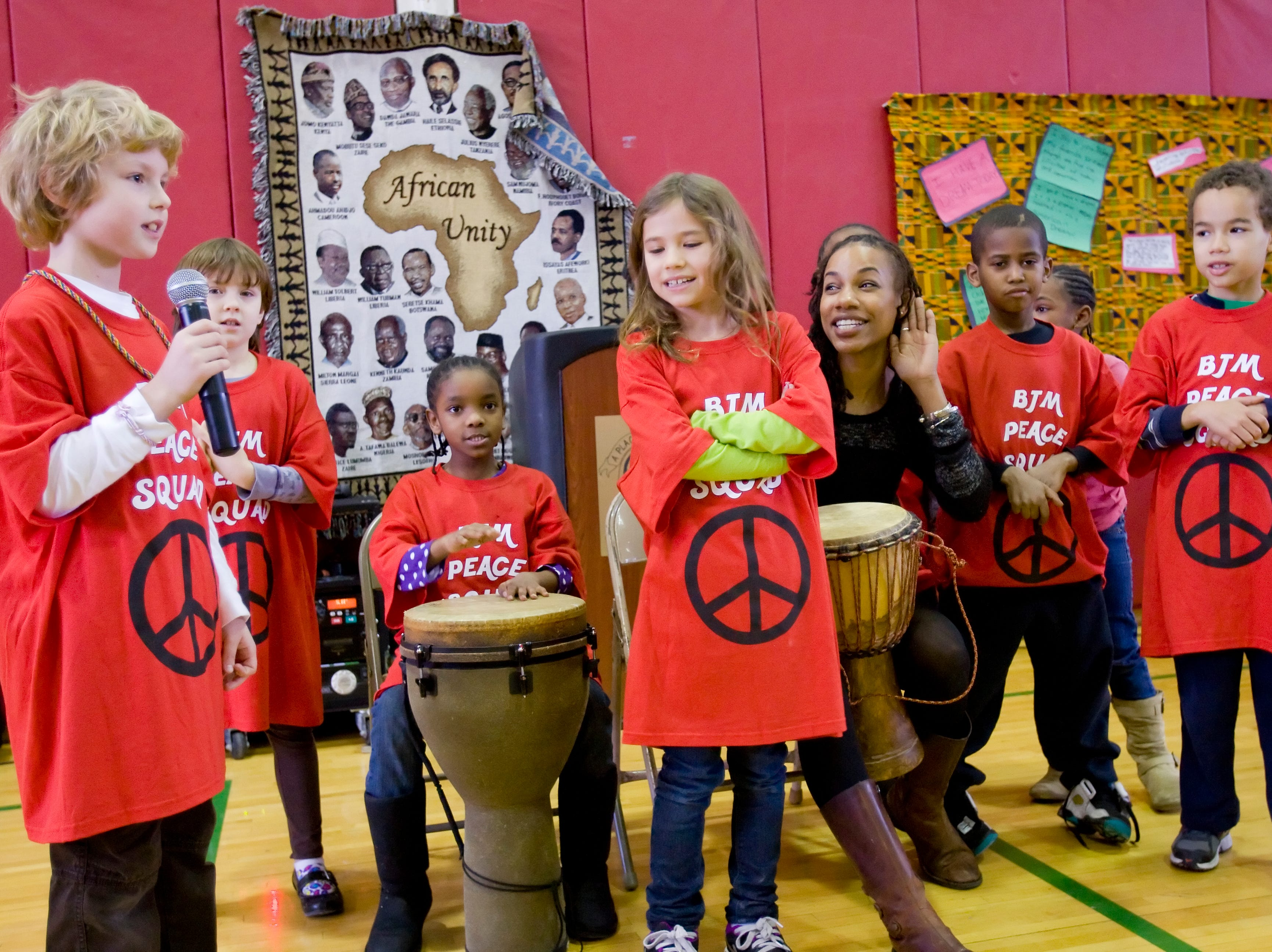 2012: Students from Millicent Clark-Maynard's third-grade class at Beverly J. Martin School, lead by Dr Nia Nunn Makepeace, perform Saturday morning near the conclusion of the annual Greater Ithaca Activities Center's Martin Luther King Breakfast.