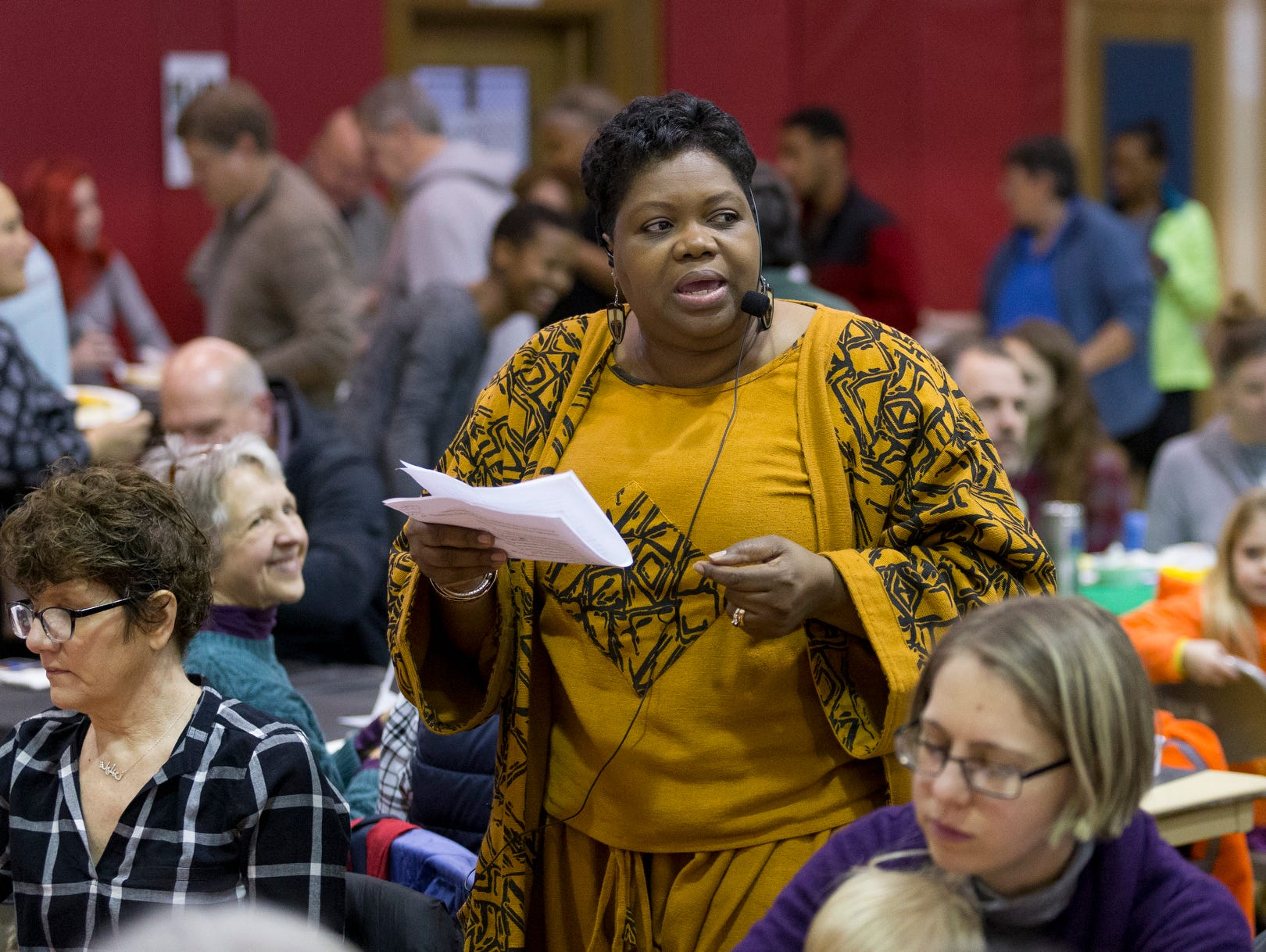 2016: Leslyn McBean Clairborne, the interim executive director of the Greater Ithaca Activities Center, delivers her welcome address Saturday morning while walking through he crowd at center's annual Martin Luther King Jr. Breakfast.