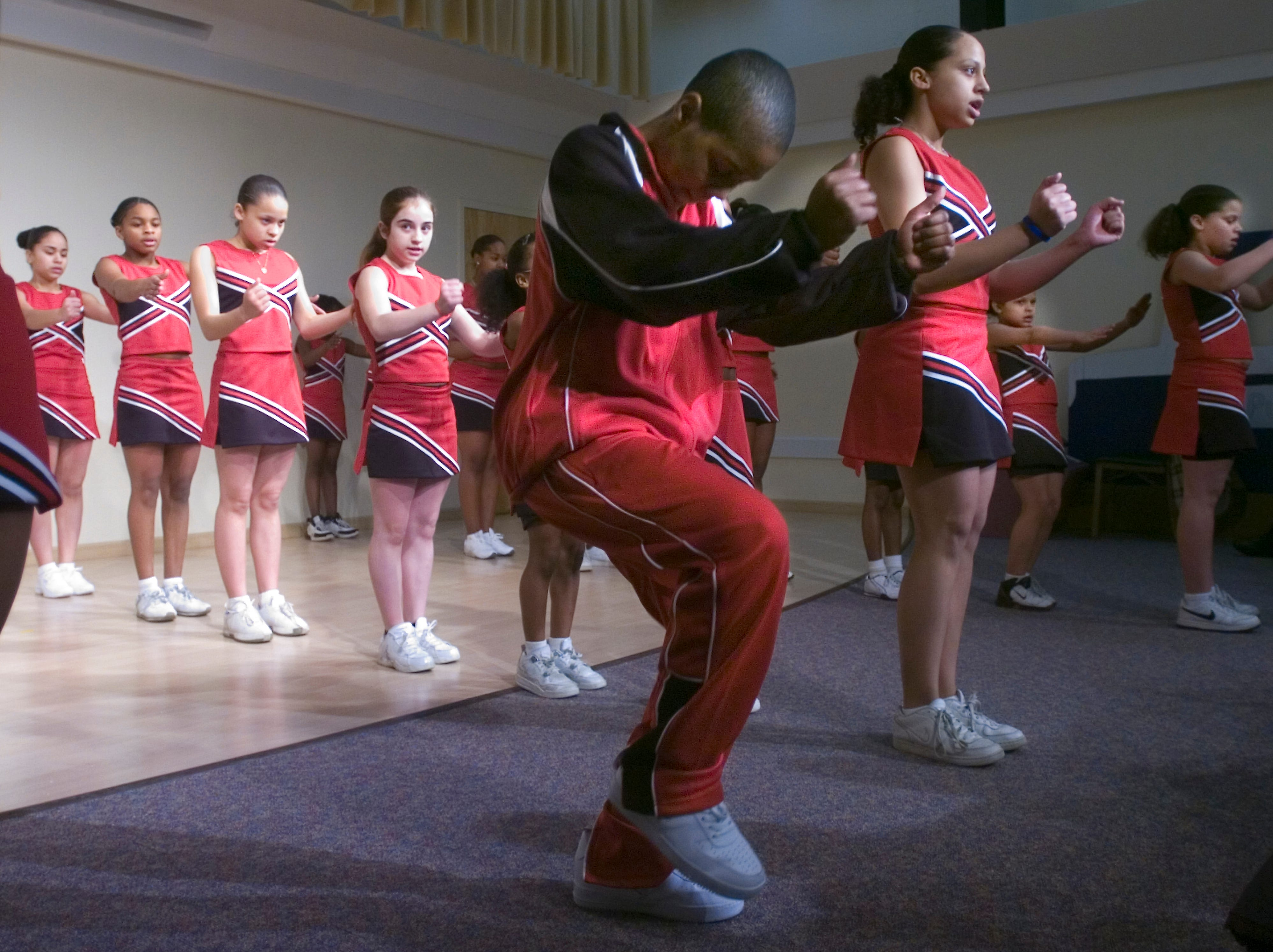 2007: Desmond Fernandez, 12, The Unexpected dance group's lone boy, starts a song as the rest of the group waits.