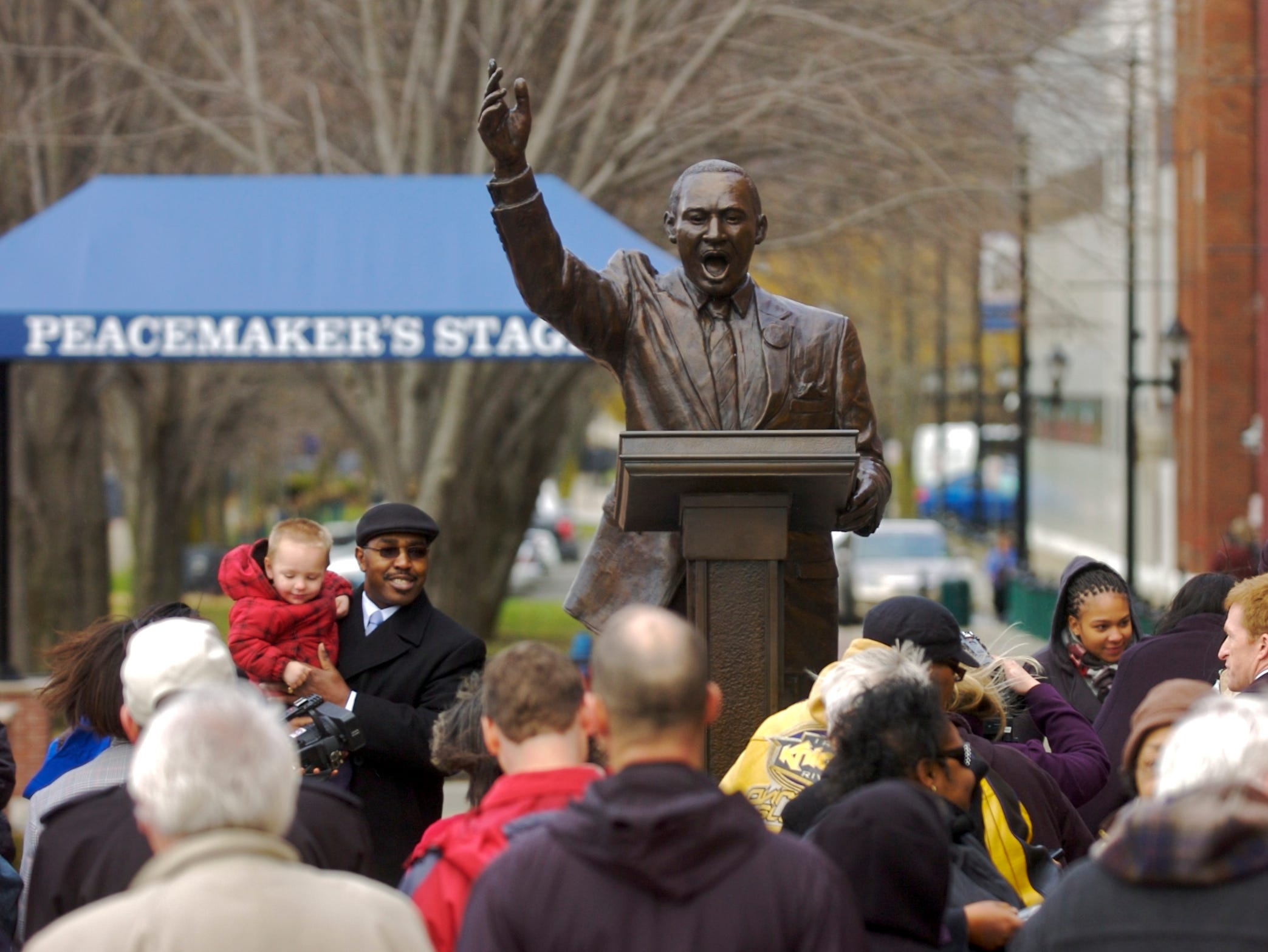 2010: The Broome County Martin Luther King, Jr. Commission was joined by city and state official Wednesday to unveil the MLK statue and Peacemakers Stage on the River Trail in downtown Binghamton.