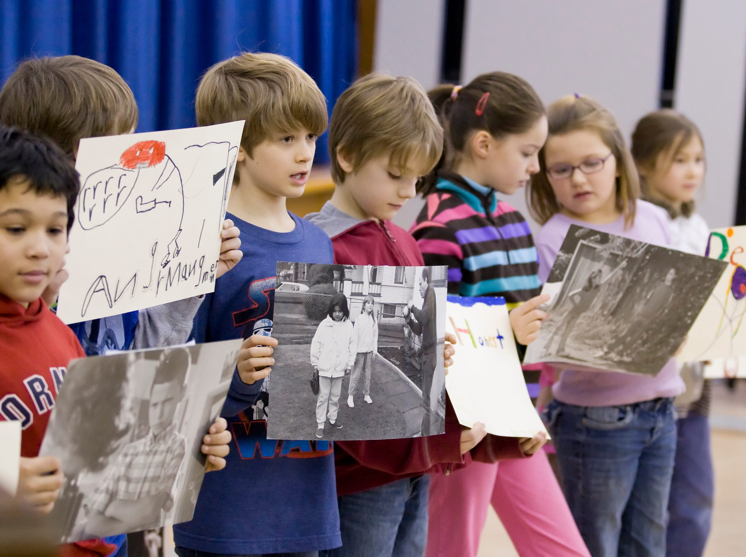 2012: Cayuga Heights Elementary School third-grade students show materials from the school's character education program, talk about how relates to their own lives and then share that with the rest of the students Friday morning at the school's Martin Luther King assembly.